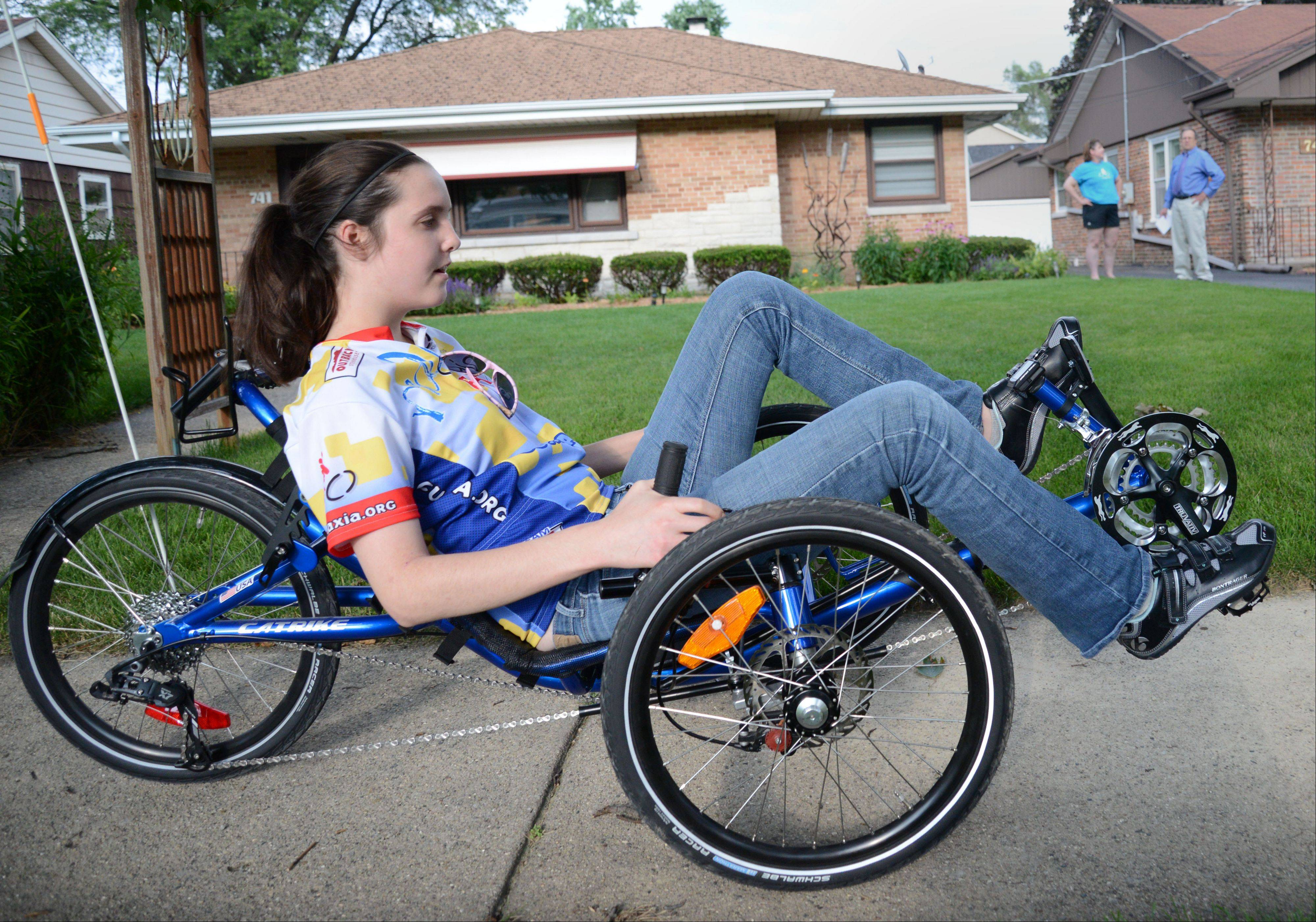 Literally racing for a cure, Nicole Kramer of Villa Park will use her new custom cycle in next Sunday's Ride Ataxia to raise funds to fight the progressive disease attacking her body.