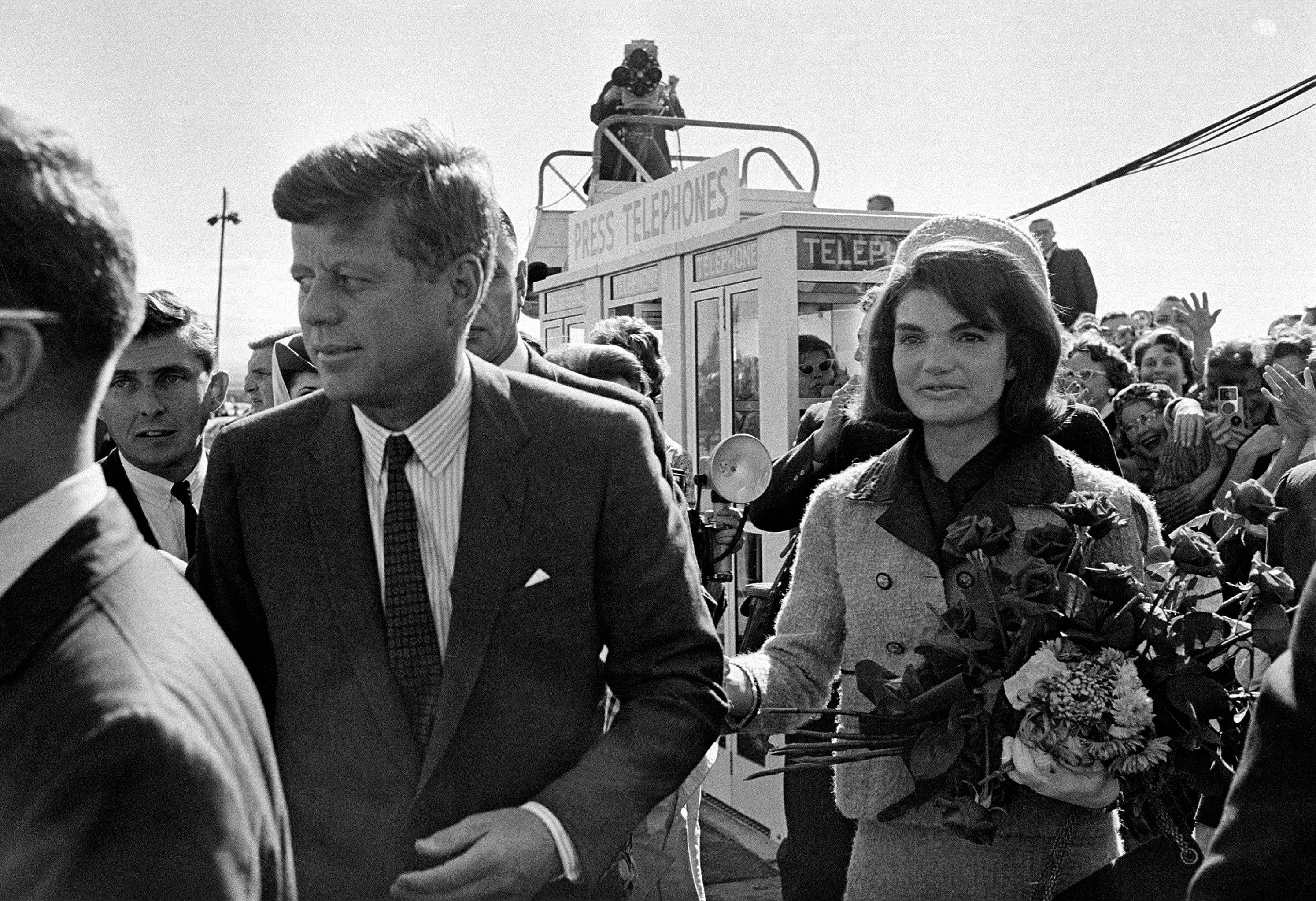 In this Nov. 22, 1963, file photo, President John F. Kennedy and his wife, Jacqueline Kennedy, arrive at Love Field airport in Dallas.