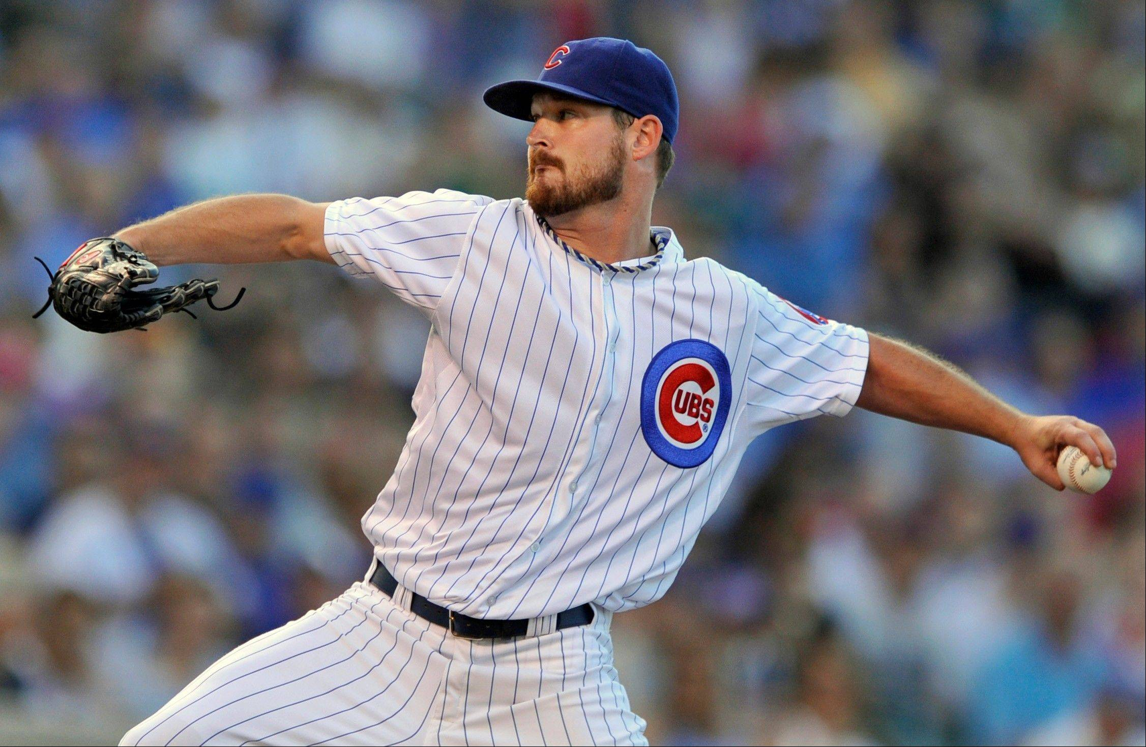 Cubs starter Travis Wood deals in Sunday's first inning at Wrigley Field.