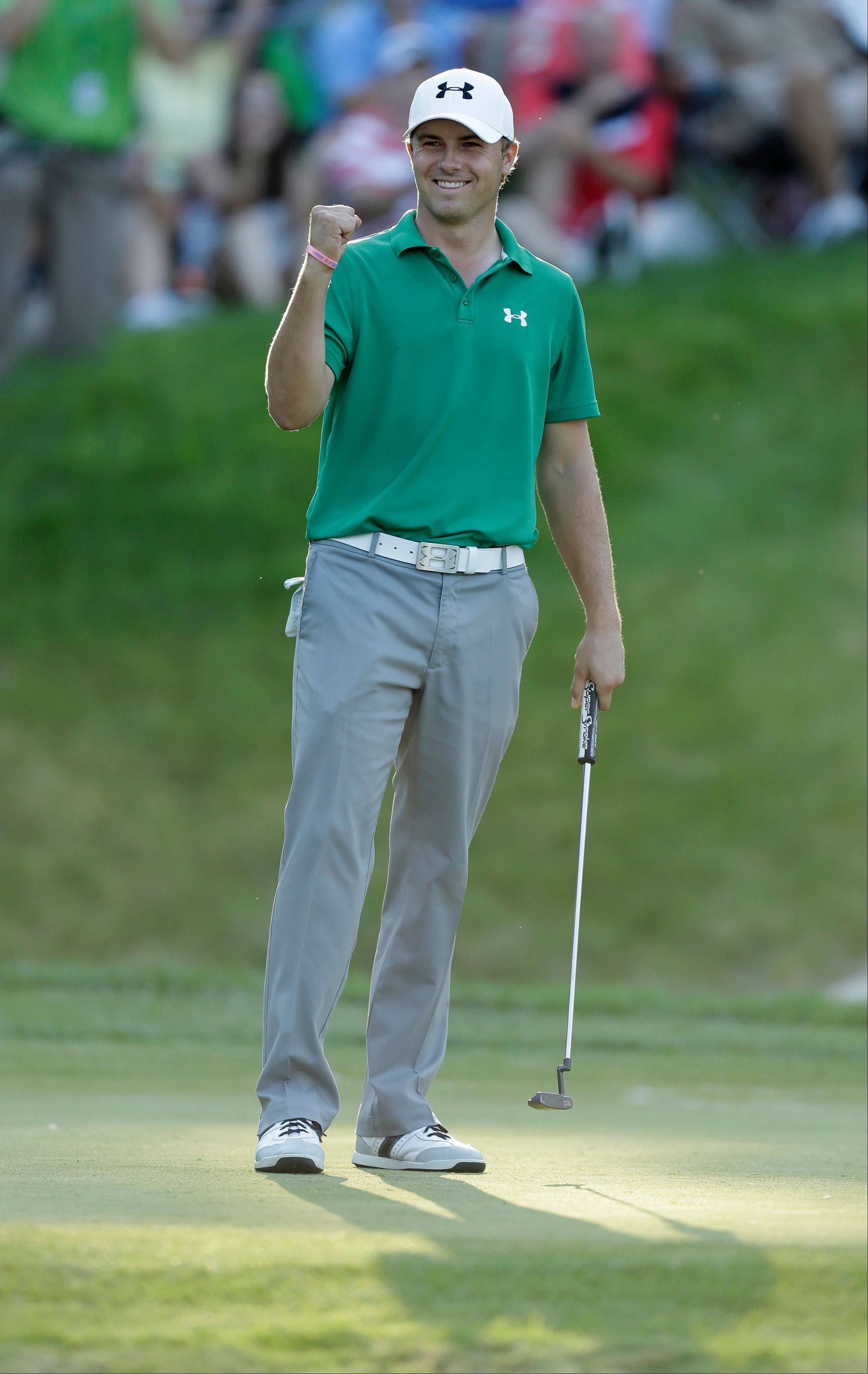 Jordan Spieth reacts after winning the John Deere Classic on Sunday at TPC Deere Run. Spieth, who is two weeks away from his 20th birthday, defeated Zach Johnson and David Hearn in a five-hole sudden-death playoff.
