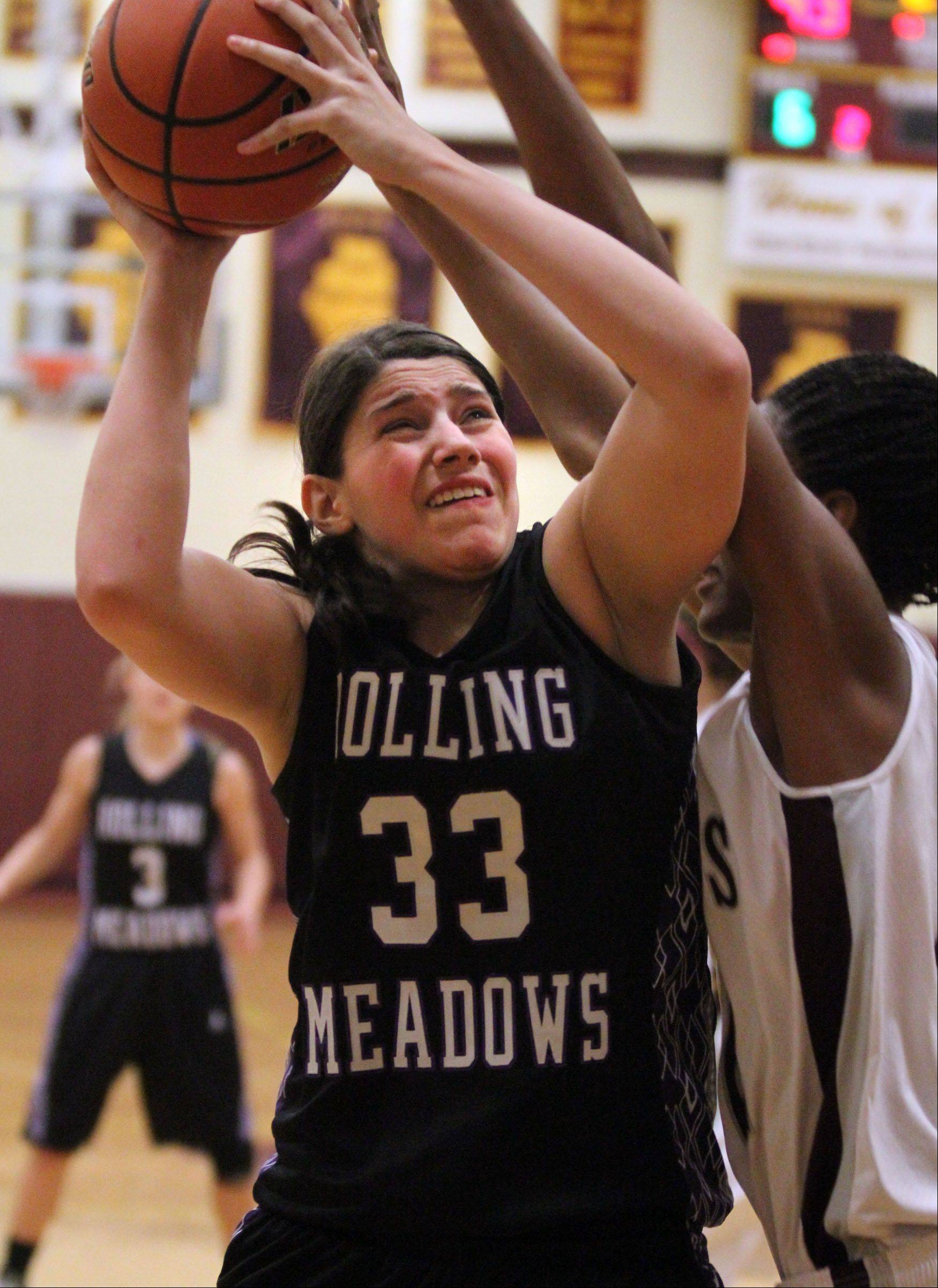 Rolling Meadows� Ashley Montanez shoots against Montini in tournament play last season in Lombard.