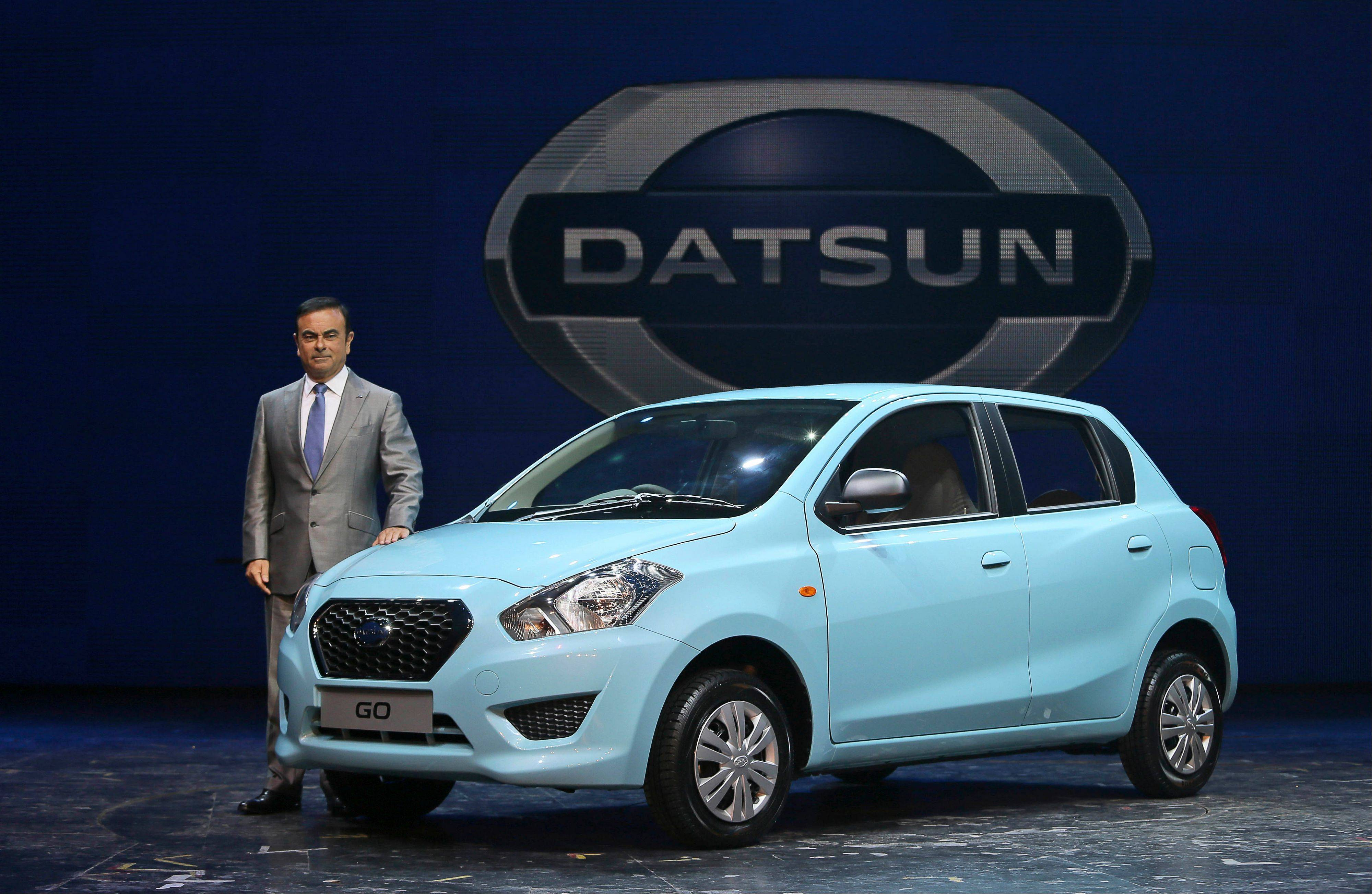 Nissan Motor Co. President and CEO Carlos Ghosn with the Datsun Go Monday during its global launch in New Delhi, India. Nissan has introduced the first new Datsun model in more than three decades in the Indian capital. The company hopes bringing back the brand that built its U.S. business will fuel growth in emerging markets with a new generation of car buyers. The re-imagined Datsun -- a five-seat hatchback -- will go on sale in India next year for about $6,670.