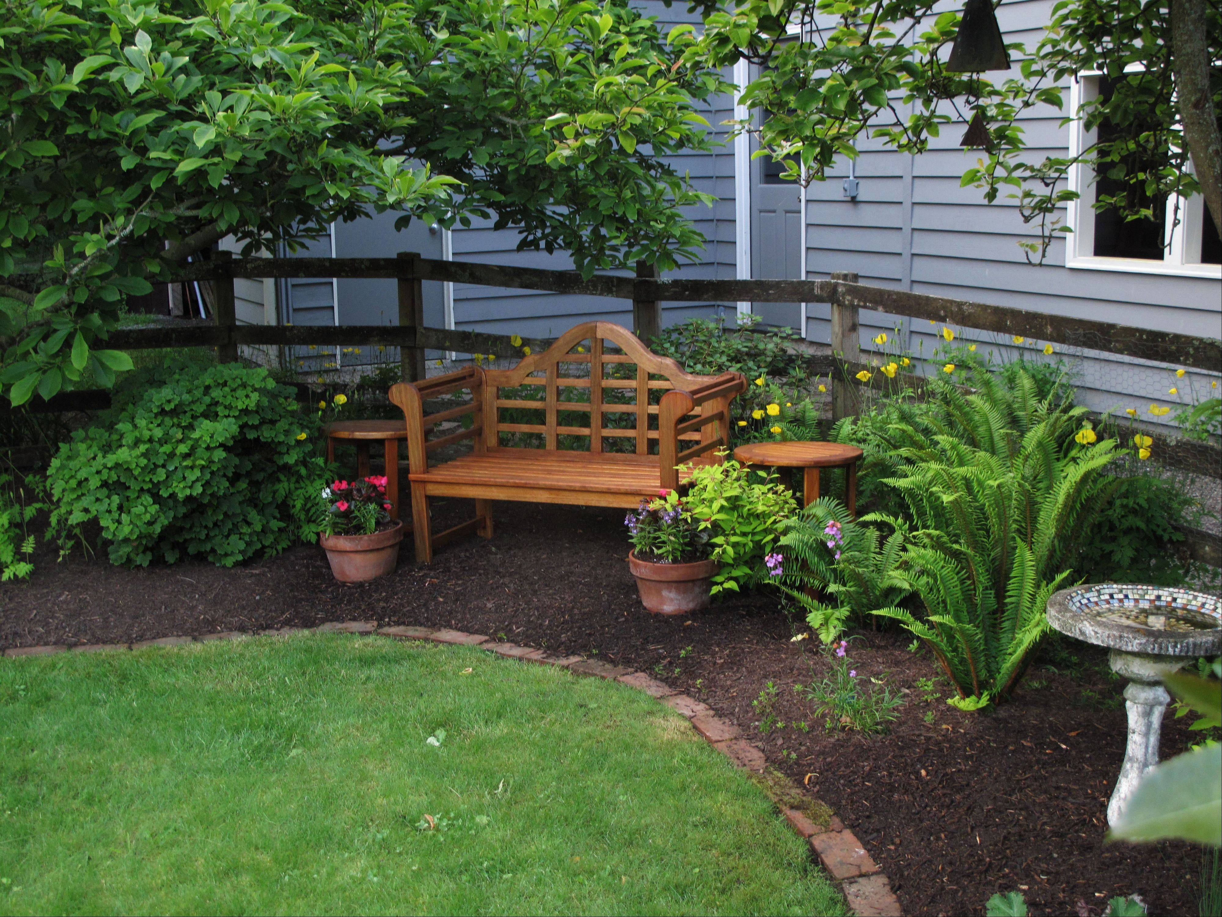 The lawn remains the centerpiece in this yard, but was greatly downsized and shaped by a landscaped perimeter consisting of furniture, statuary and a variety of perennials, in Langley, Wash. Less mowing, less watering and fewer chemicals was the result. It attracts more wildlife, too.