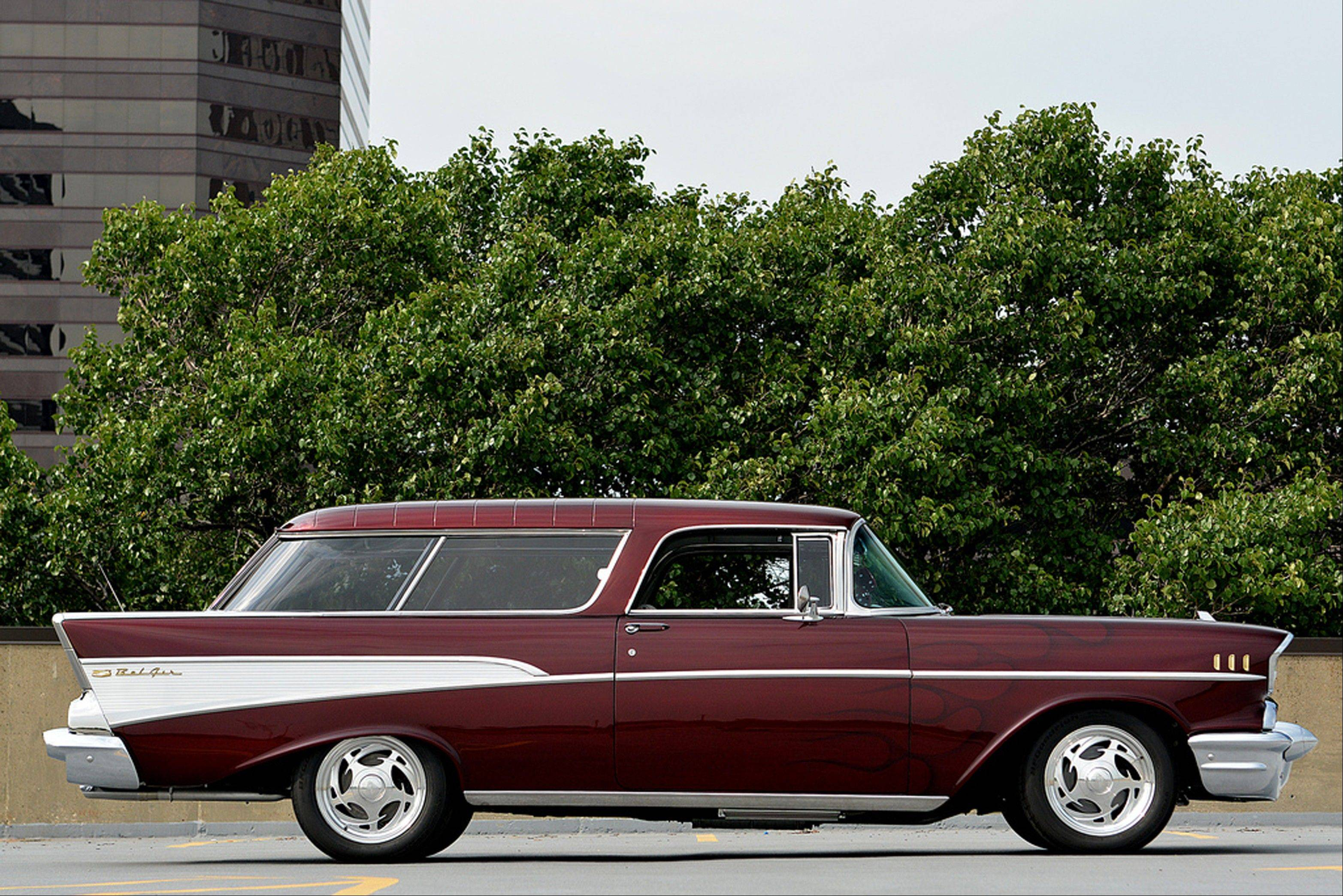 This 1957 Chevrolet Nomad pops with House of Kolor Candy Brandywine paint finished with ghost flames.