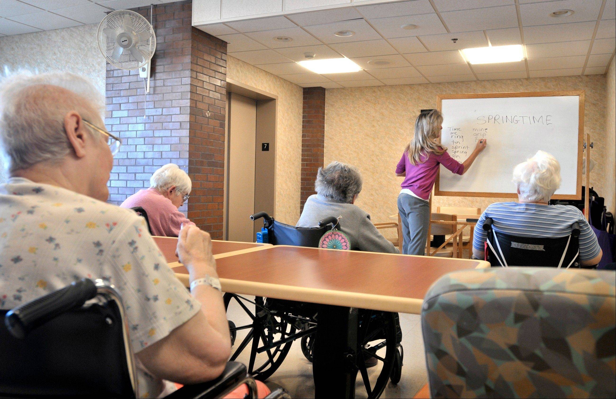 Tina Reese leads a word game for residents at a nursing home in Lancaster, Pa. If you're lucky enough to live into your 90s, how well will your brain hold up? You may have an edge over people who've reached that age already, a new study hints.