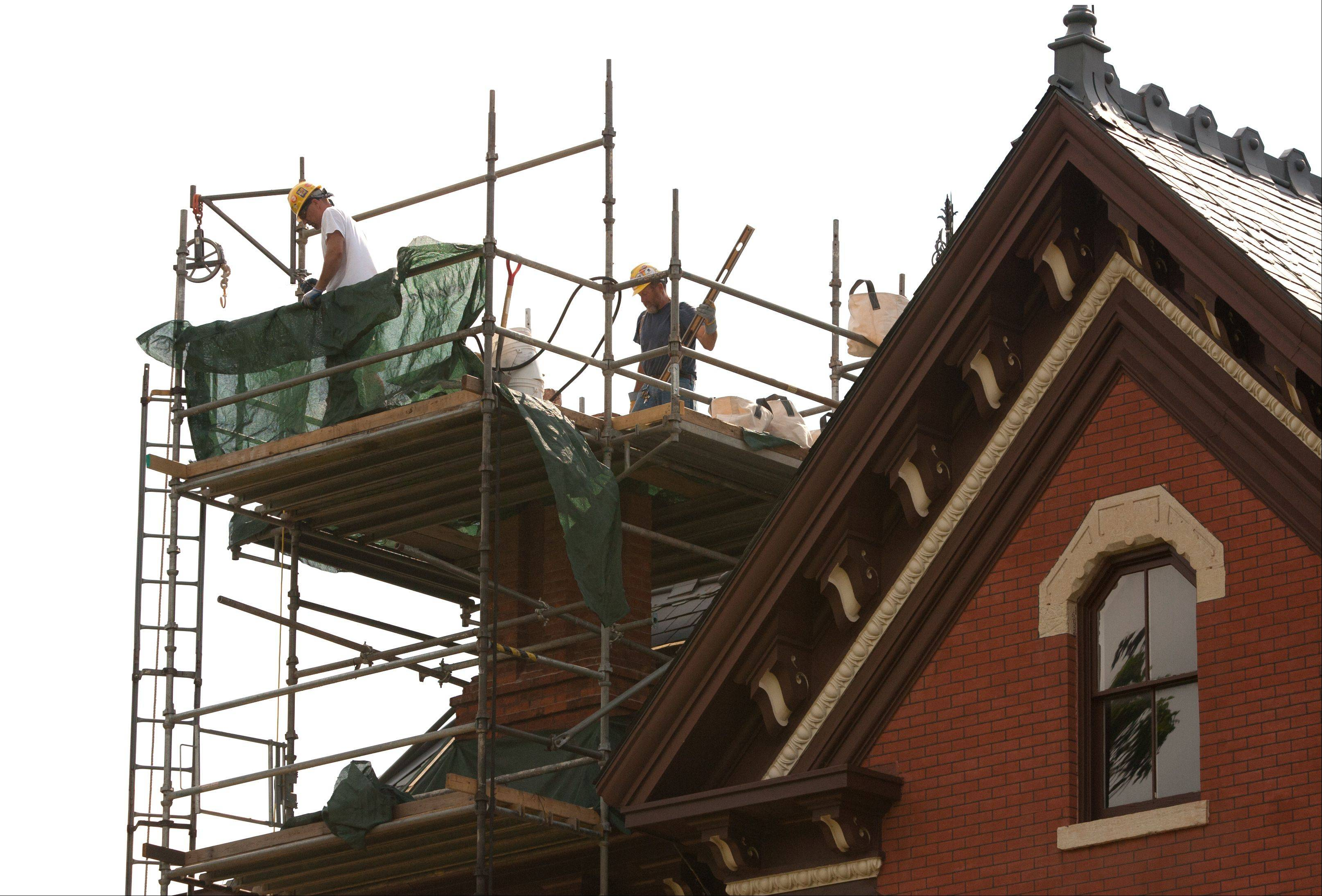 Berglund Construction of Chicago is making emergency repairs to the two tall chimneys at the Martin Mitchell Mansion on the grounds of Naper Settlement in Naperville. The chimneys were found to be in need of immediate fixes during a building assessment in May.