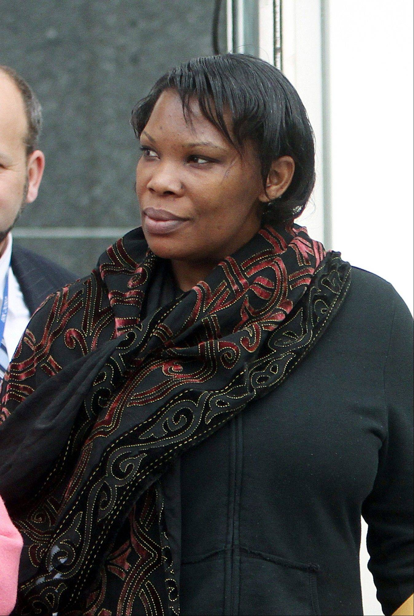 In this Thursday, April 12, 2012 file photo, Beatrice Munyenyezi leaves the federal court in Concord, N.H. A federal judge Monday, July 15, 2013, sentenced her to 10 years in prison after she was convicted of lying about her role in the 1994 Rwanda genocide to come to the US and eventually obtain citizenship.