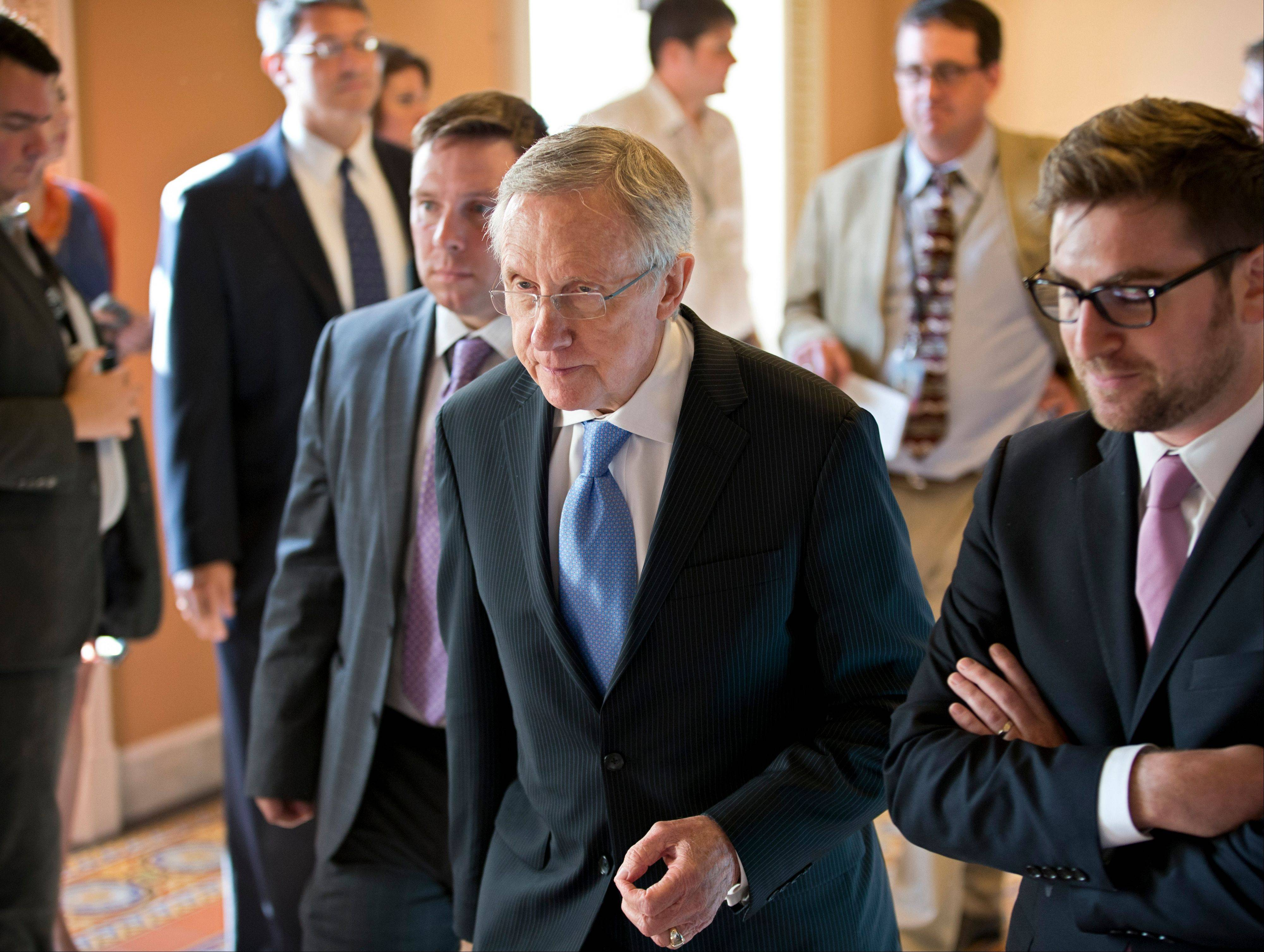 Senate Majority Leader Harry Reid, center, walks to closed-door meeting in the Old Senate Chamber for a showdown over presidential nominees that have been blocked by a GOP filibuster, at the Capitol in Washington, Monday.
