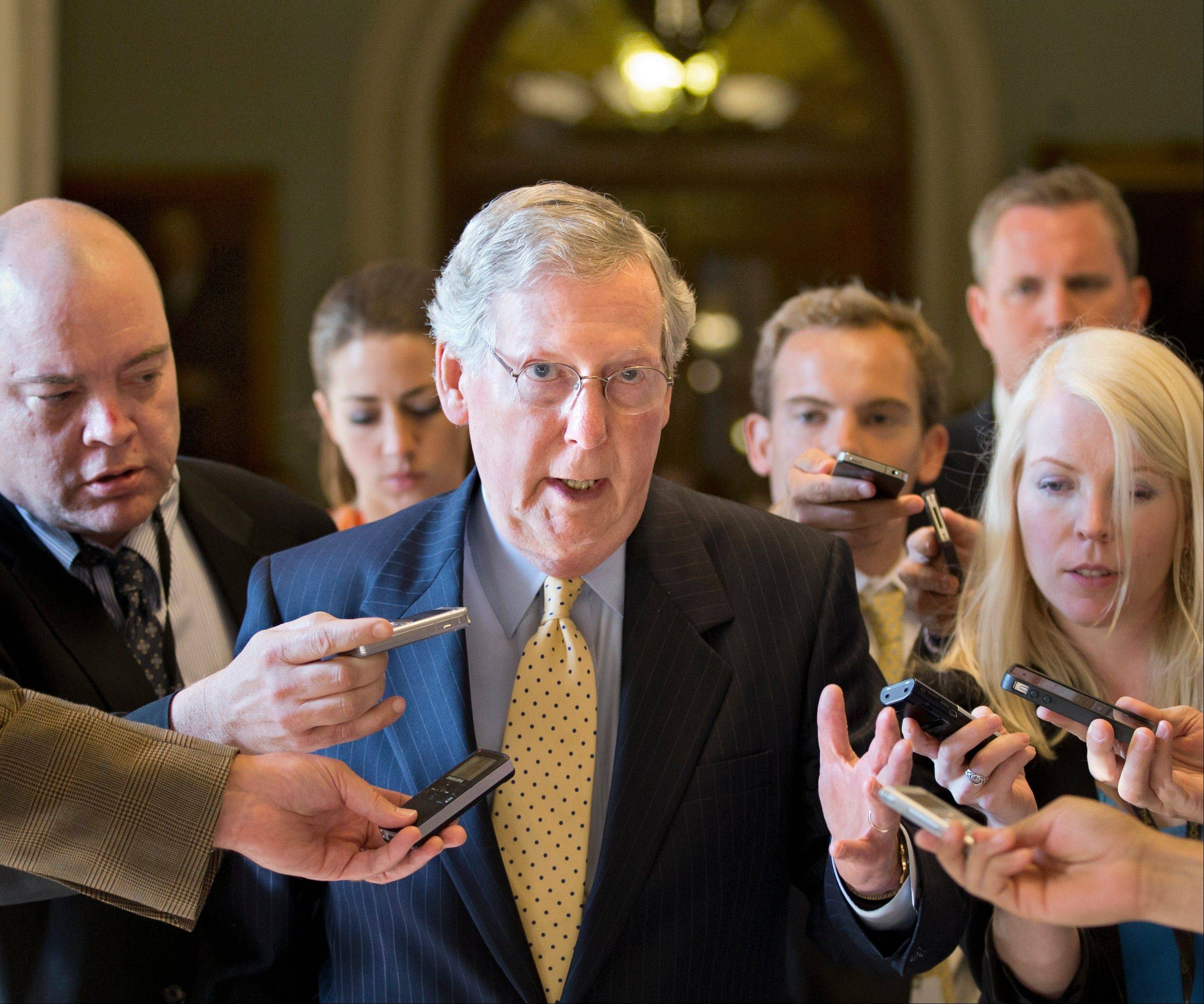 Senate Republican Leader Mitch McConnell of Kentucky is surrounded by reporters as he returns to his office after meeting with Senate Majority Leader Harry Reid at the Capitol in Washington Monday.