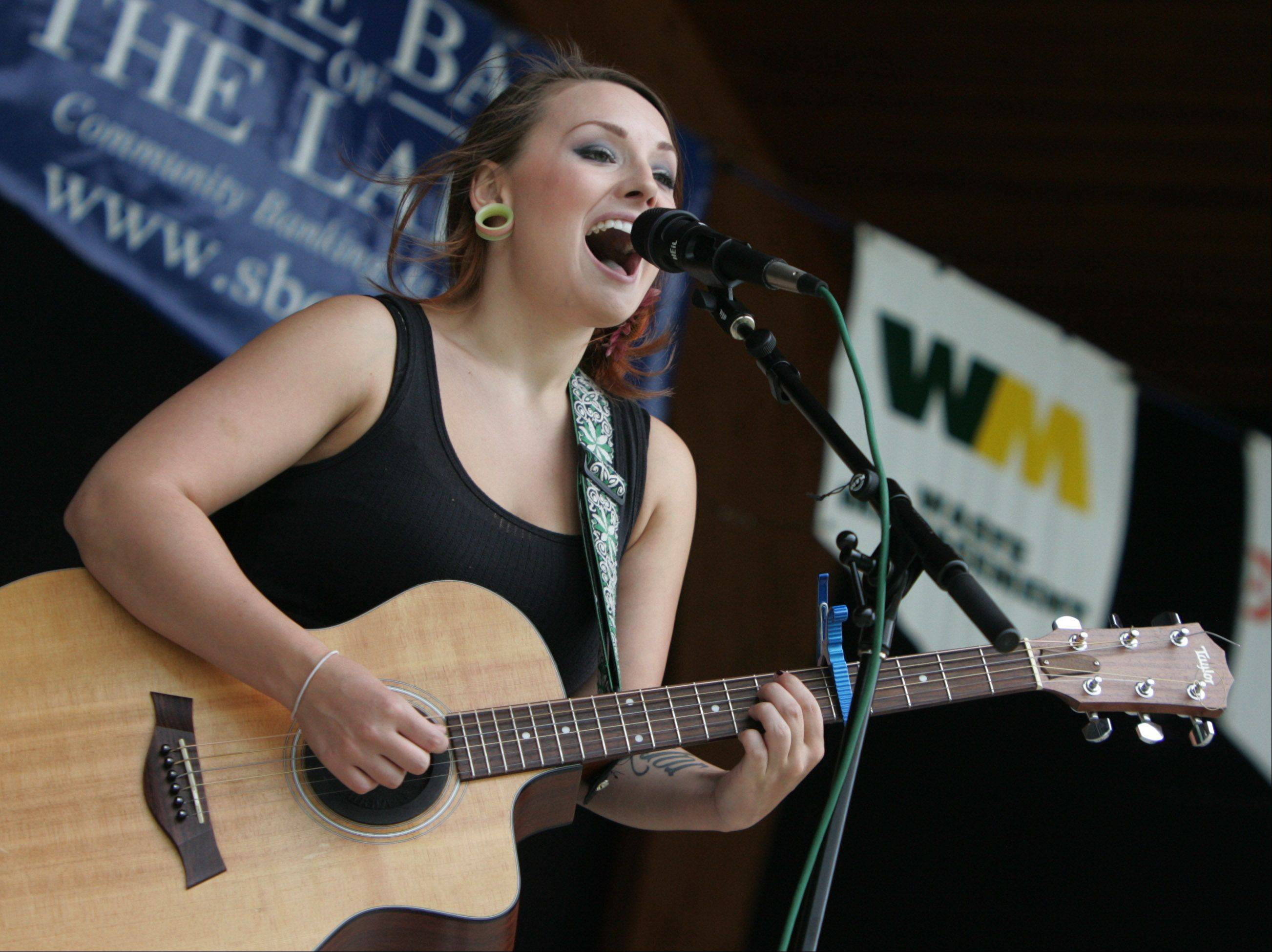 Entertainer Rachel Marie sings on the main stage during the Antioch Taste of Summer.