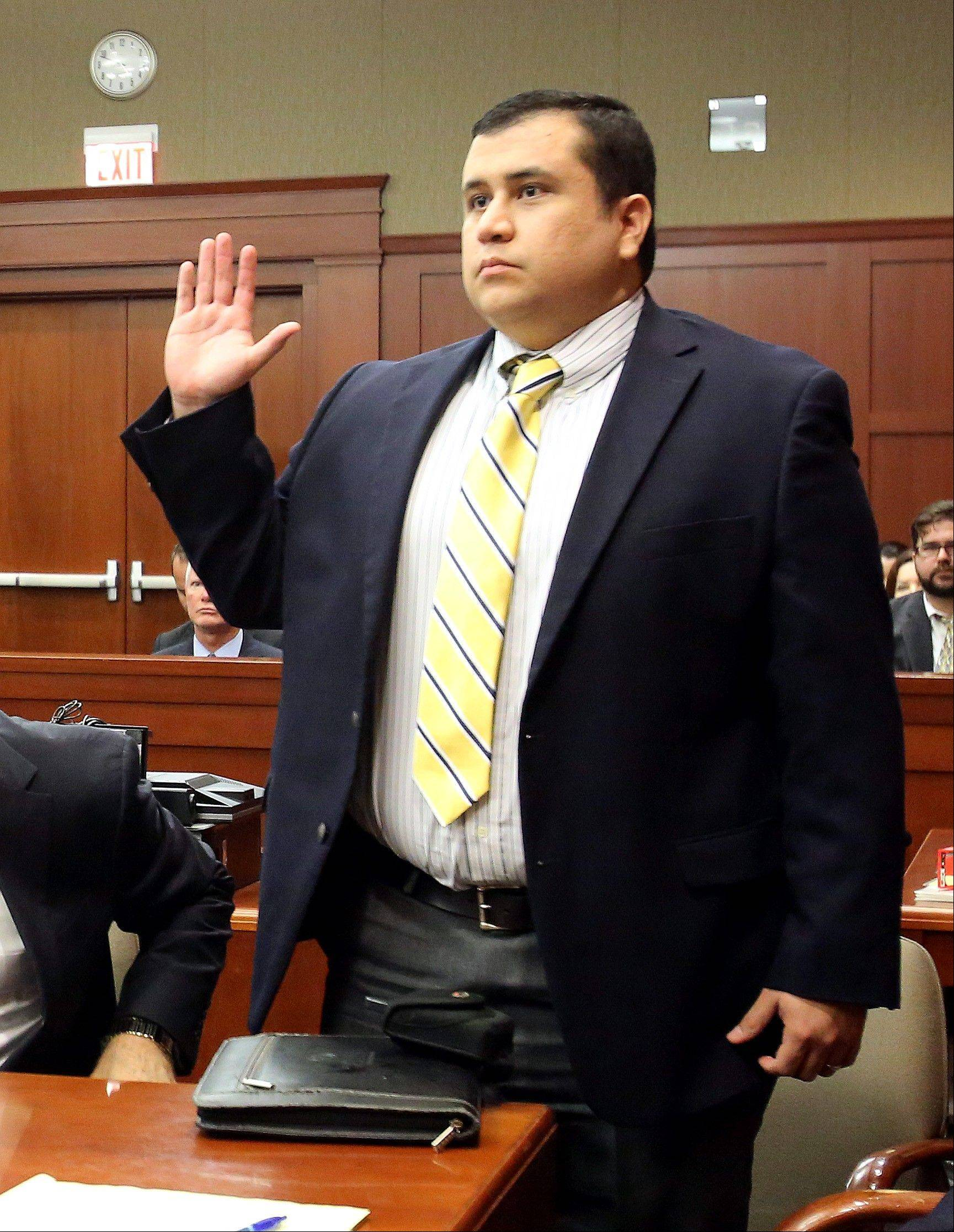 In this April 30, 2013, file photo, defendant George Zimmerman is sworn in for testimony in Seminole circuit court, in Sanford, Fla., during a pre-trial hearing. The jury cleared Zimmerman of all charges on Saturday, July 13, 2013.