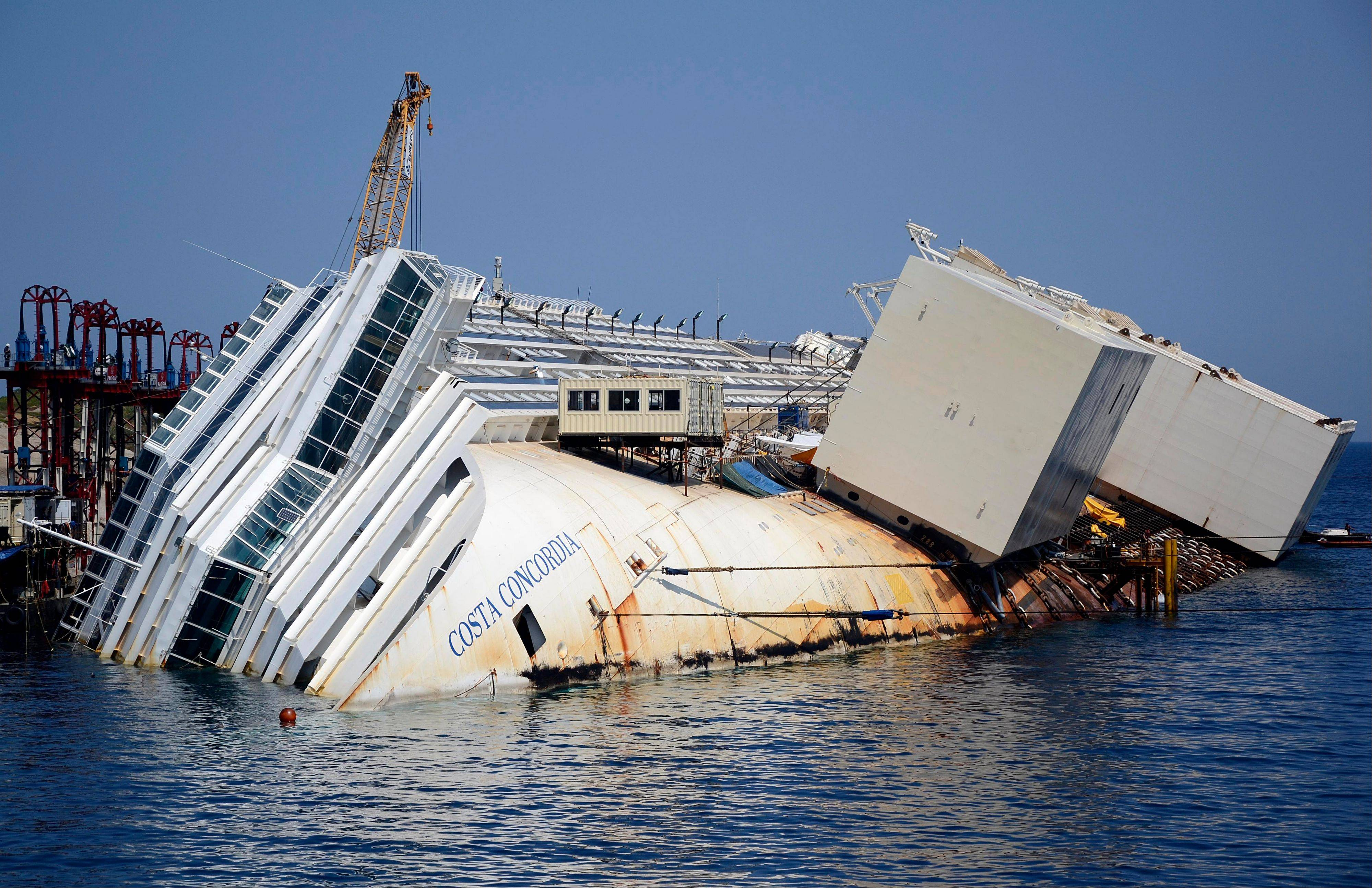 The Costa Concordia cruise ship lies on its side in the Tuscan Island of Isola del Giglio, Monday, July 15. Salvage crews are working against time to right and remove the shipwrecked Costa Concordia cruise ship, which is steadily compressing down on itself from sheer weight onto its granite seabed perch off the Tuscan island of Giglio.