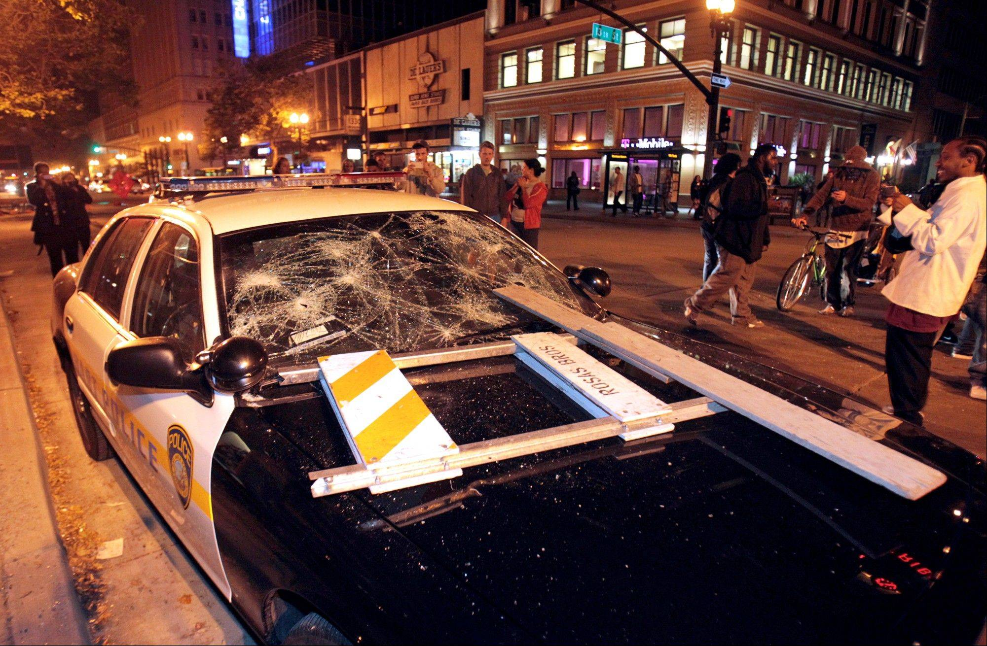 A BART police vehicle is vandalized during a protest after George Zimmerman was found not guilty in the 2012 shooting death of teenager Trayvon Martin early Sunday in Oakland, Calif.