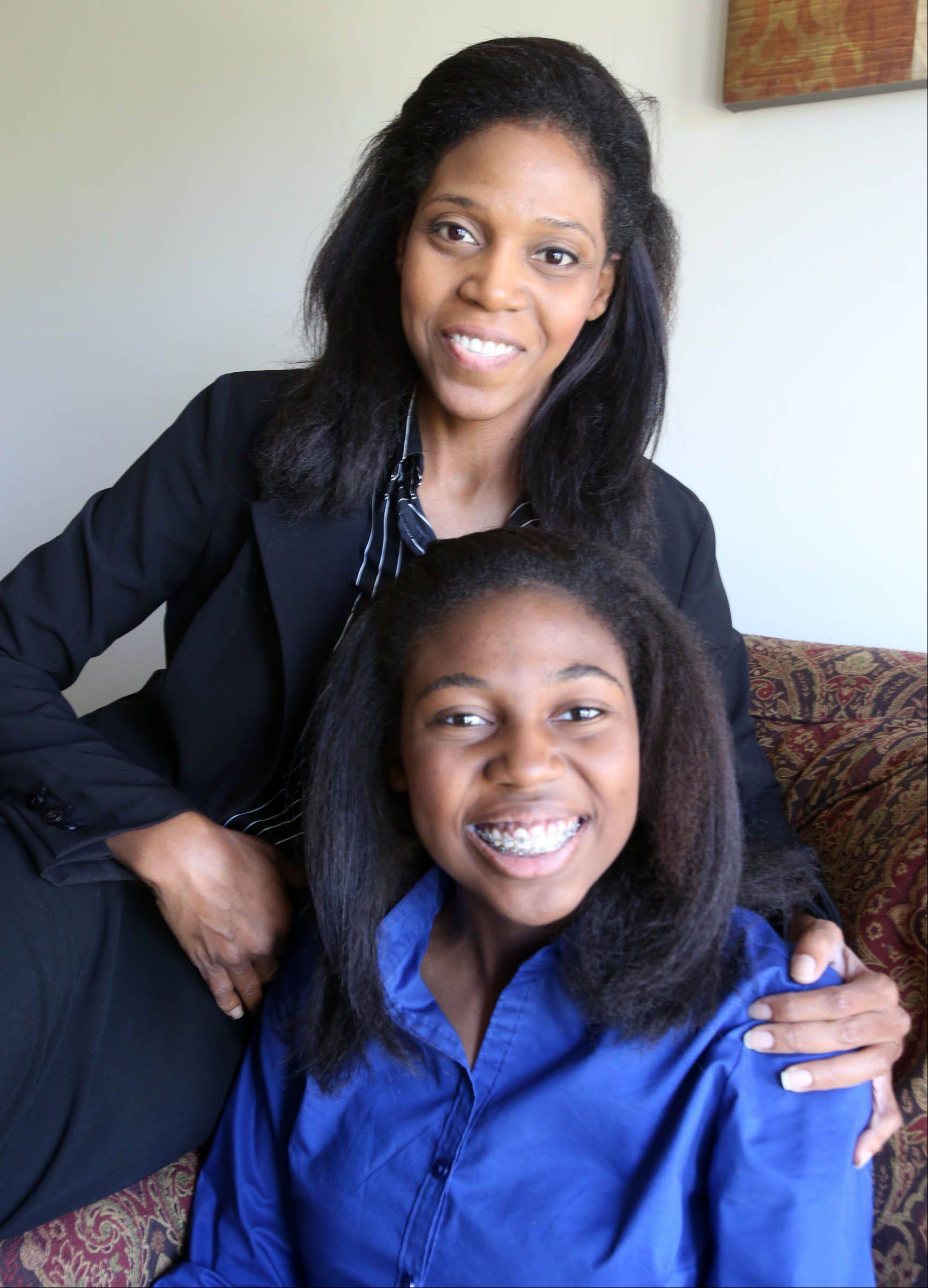 Thessalonika Arzu-Embry with her mother (and schoolmate), Wonder Embry, at their home at Great Lakes. Thessalonika, 14, will be graduating from Chicago State University in August with a bachelor's degree in psychology.