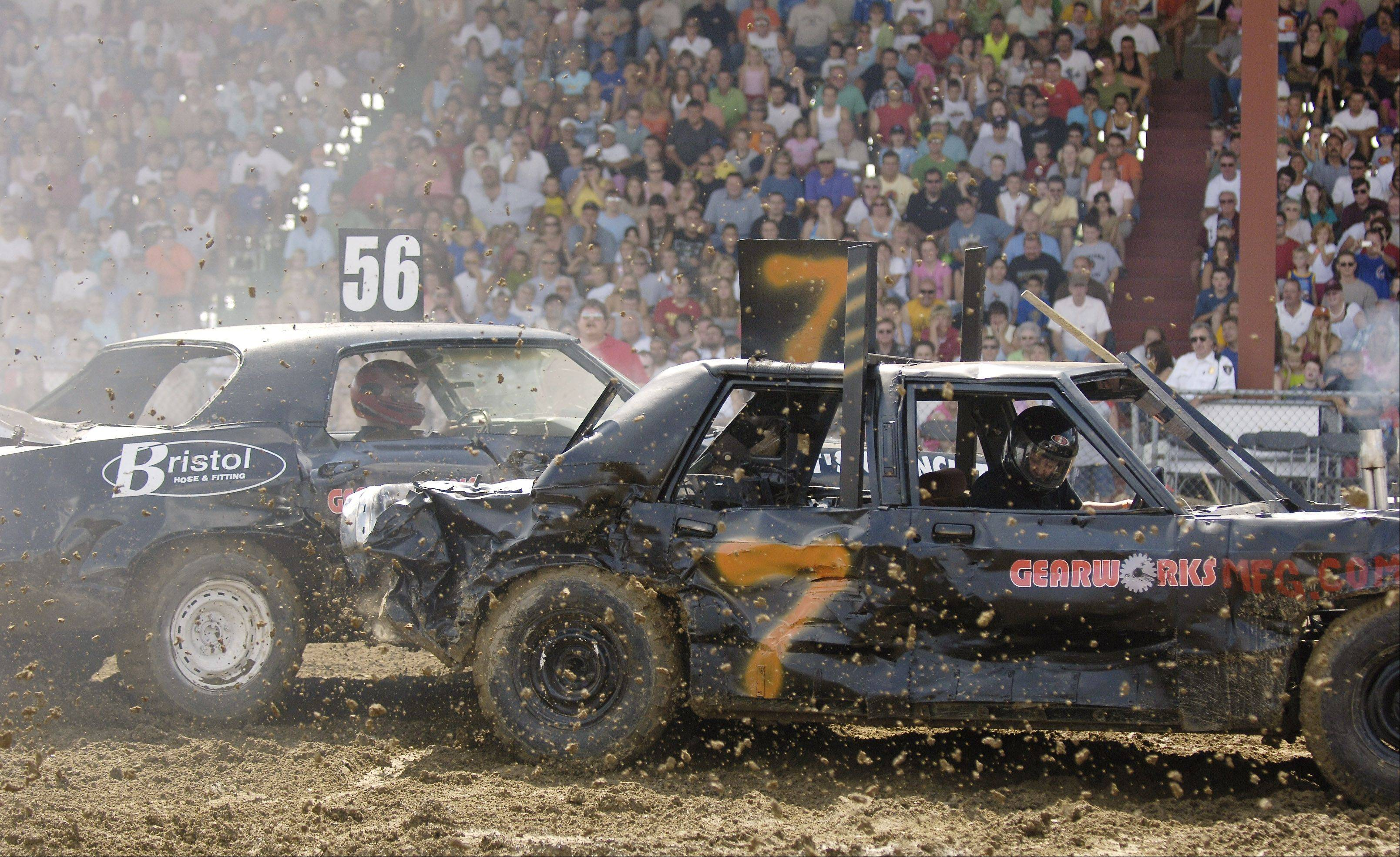 Carolyn Johnson, 22, of Melrose Park in car number 7 competes against three other cars in the demolition derby at the Kane County Fair in St. Charles.