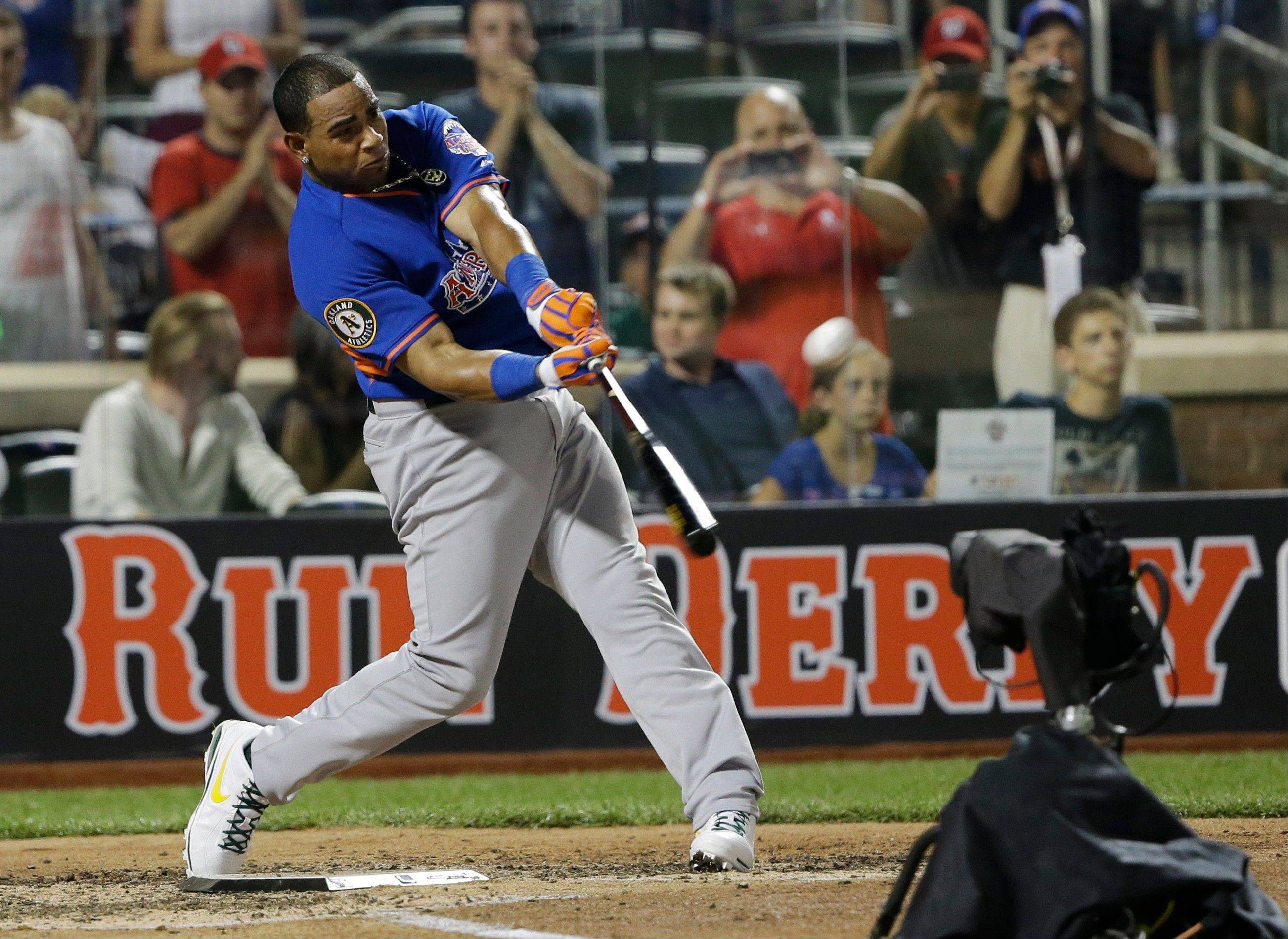 American League slugger Yoenis Cespedes of the Oakland Athletics hits his ninth home run in Monday's third round to win the MLB All-Star Home Run Derby at Citi Field in New York.