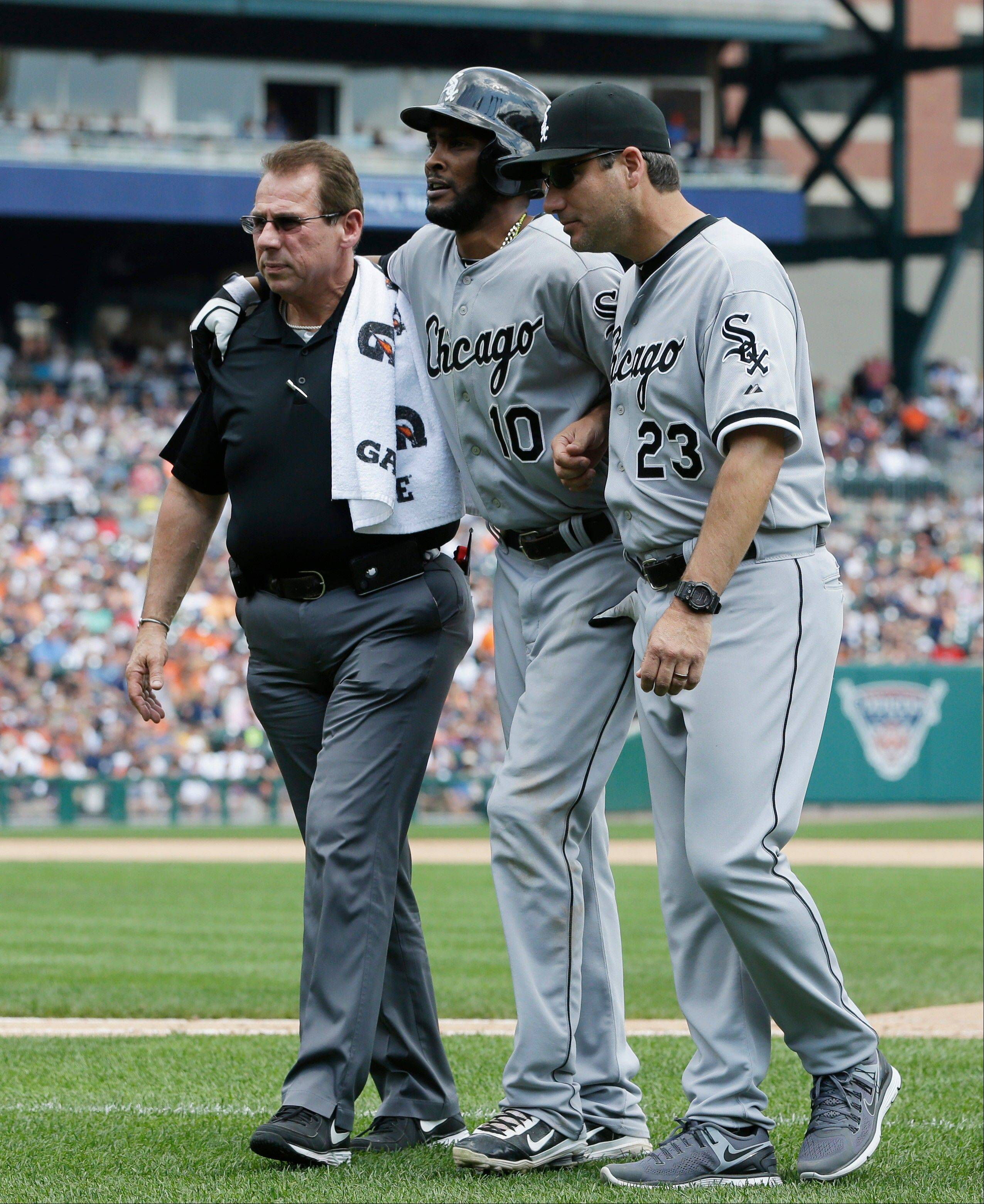 White Sox manager Robin Ventura, here helping shortstop Alexei Ramirez off the field during a game last week, has seen his team limp to a 37-55 record, the franchise's worst mark at the all-star break since 1989.