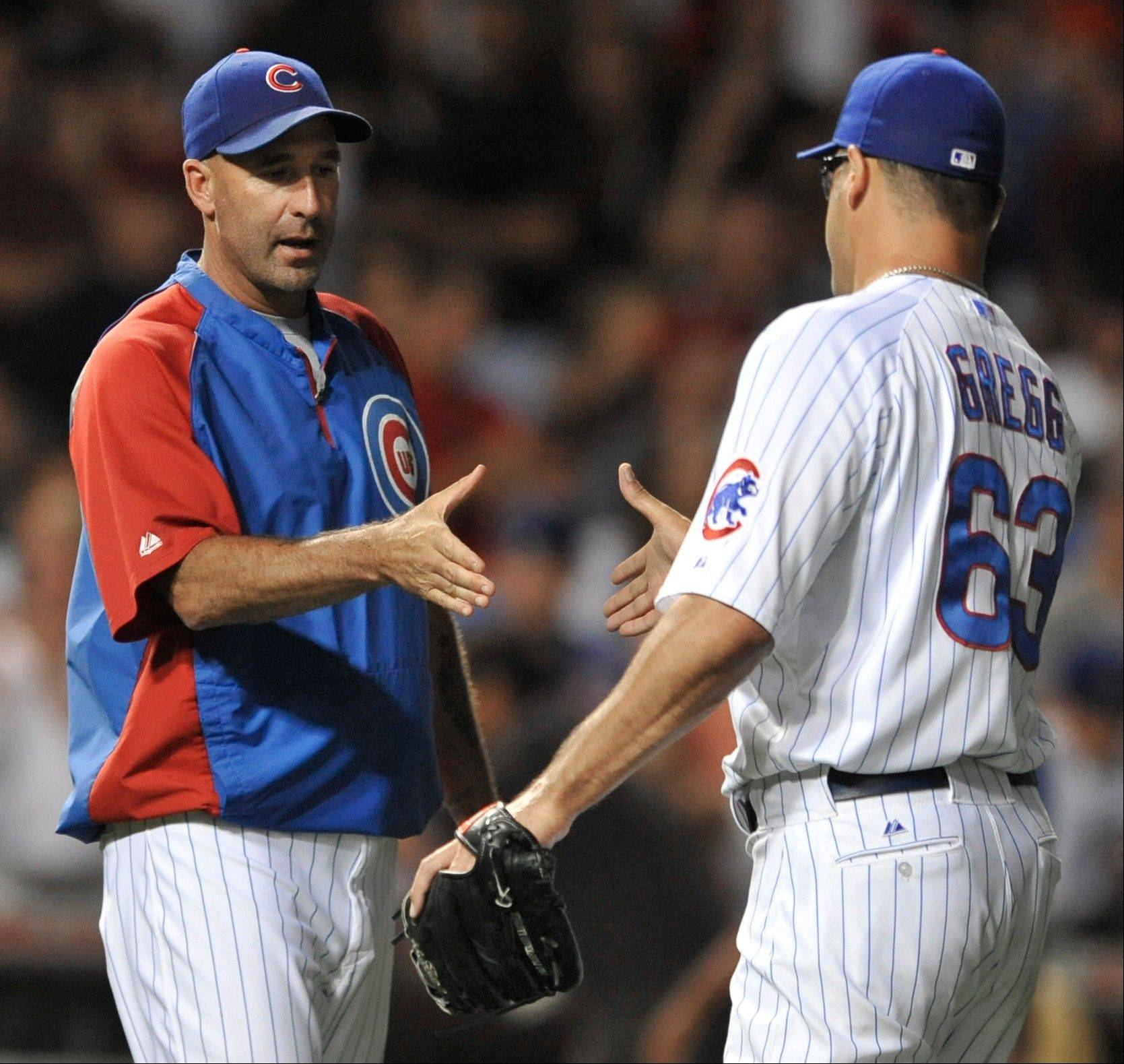 Cubs manager Dale Sveum, here congratulating closer Kevin Gregg after a victory over the Cardinals, has had to deal with a bullpen issue through most of the season's first half.