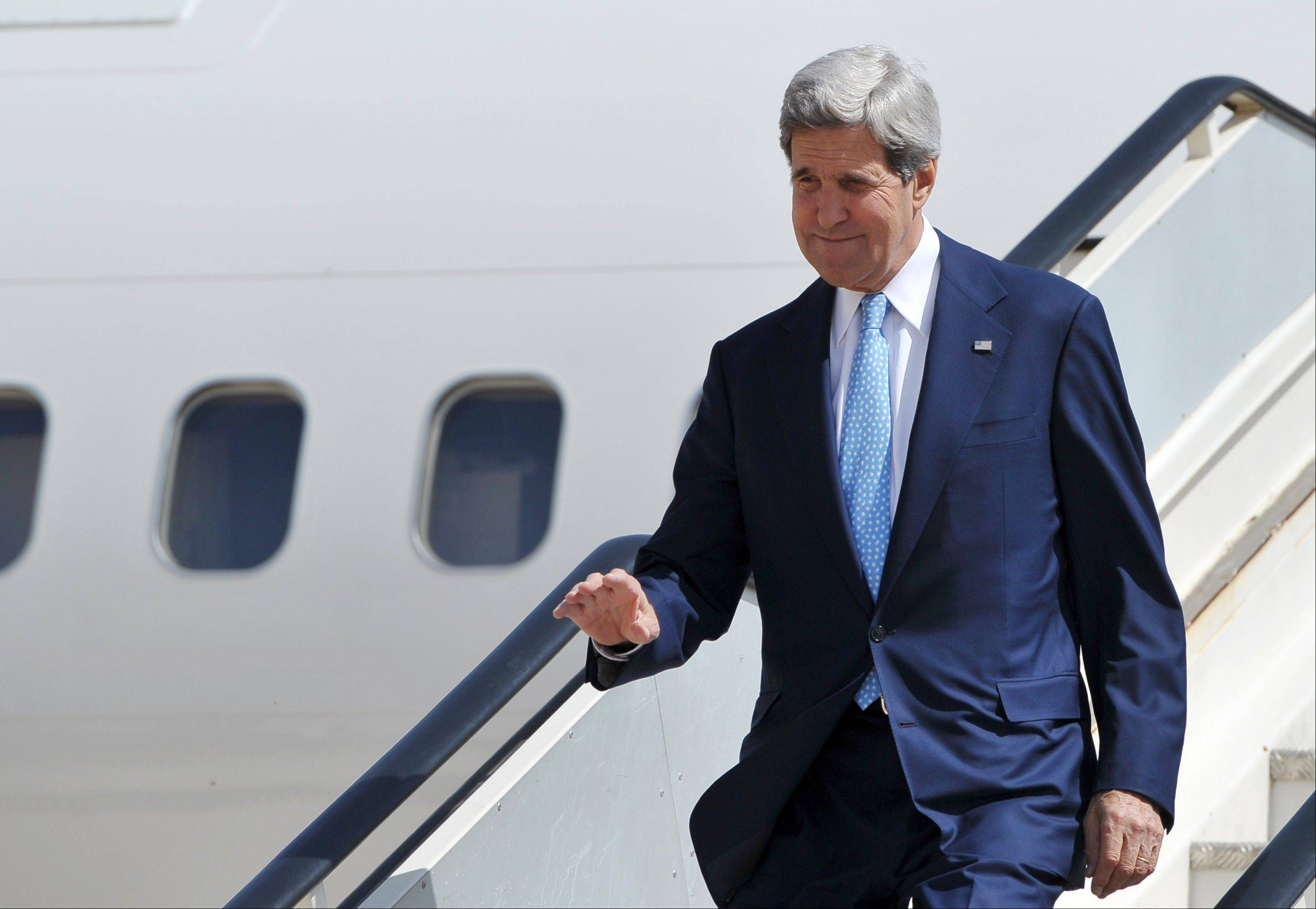 U.S. Secretary of State John Kerry steps off his plane upon his arrival at Queen Alia International Airport in Amman, Jordan on Tuesday, July 16, 2013. Kerry headed to Jordan on his sixth trip to the region as he tries to push Israelis and Palestinians back to peace talks.