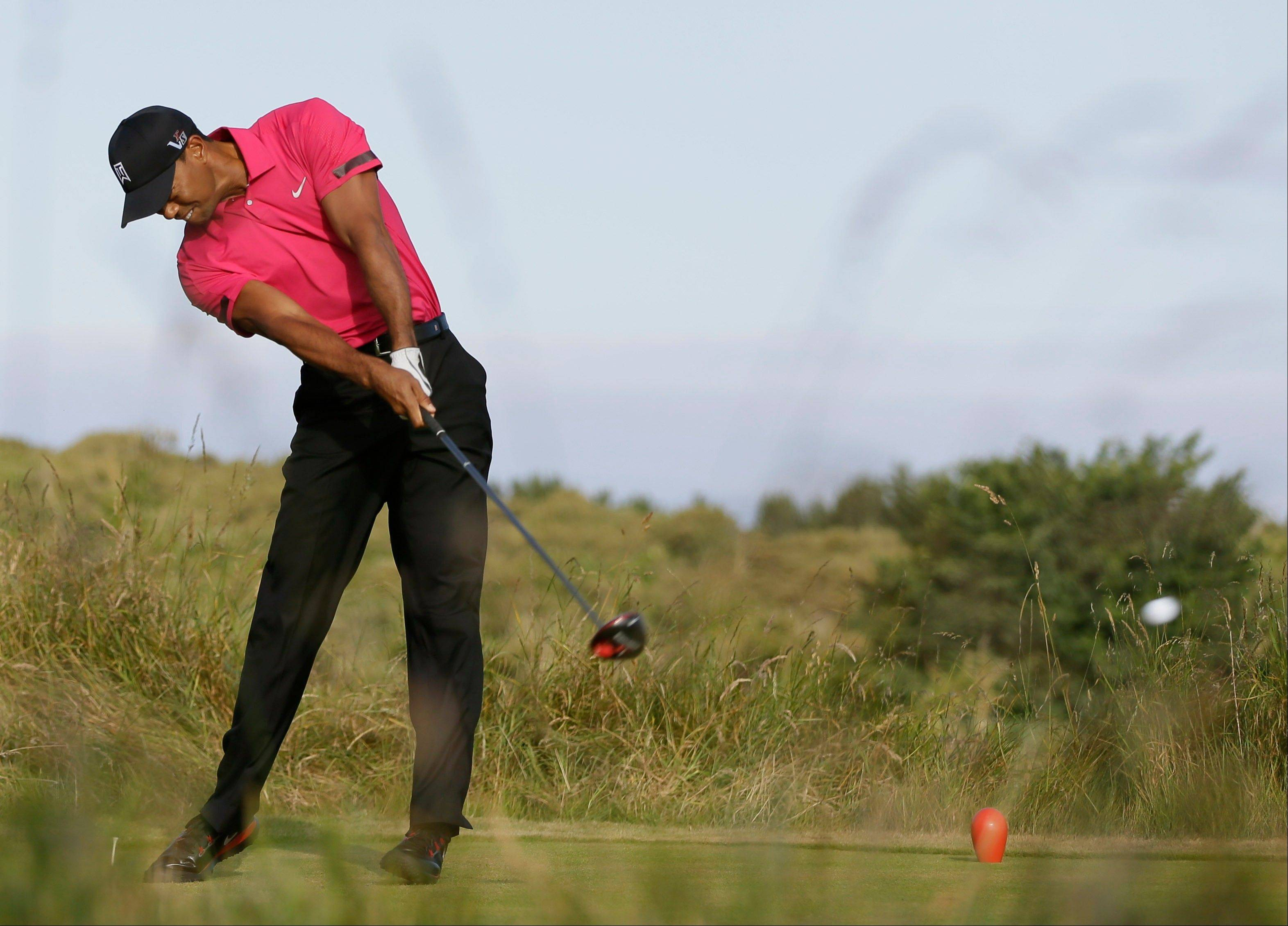 Tiger Woods says elbow fine, no loss of confidence