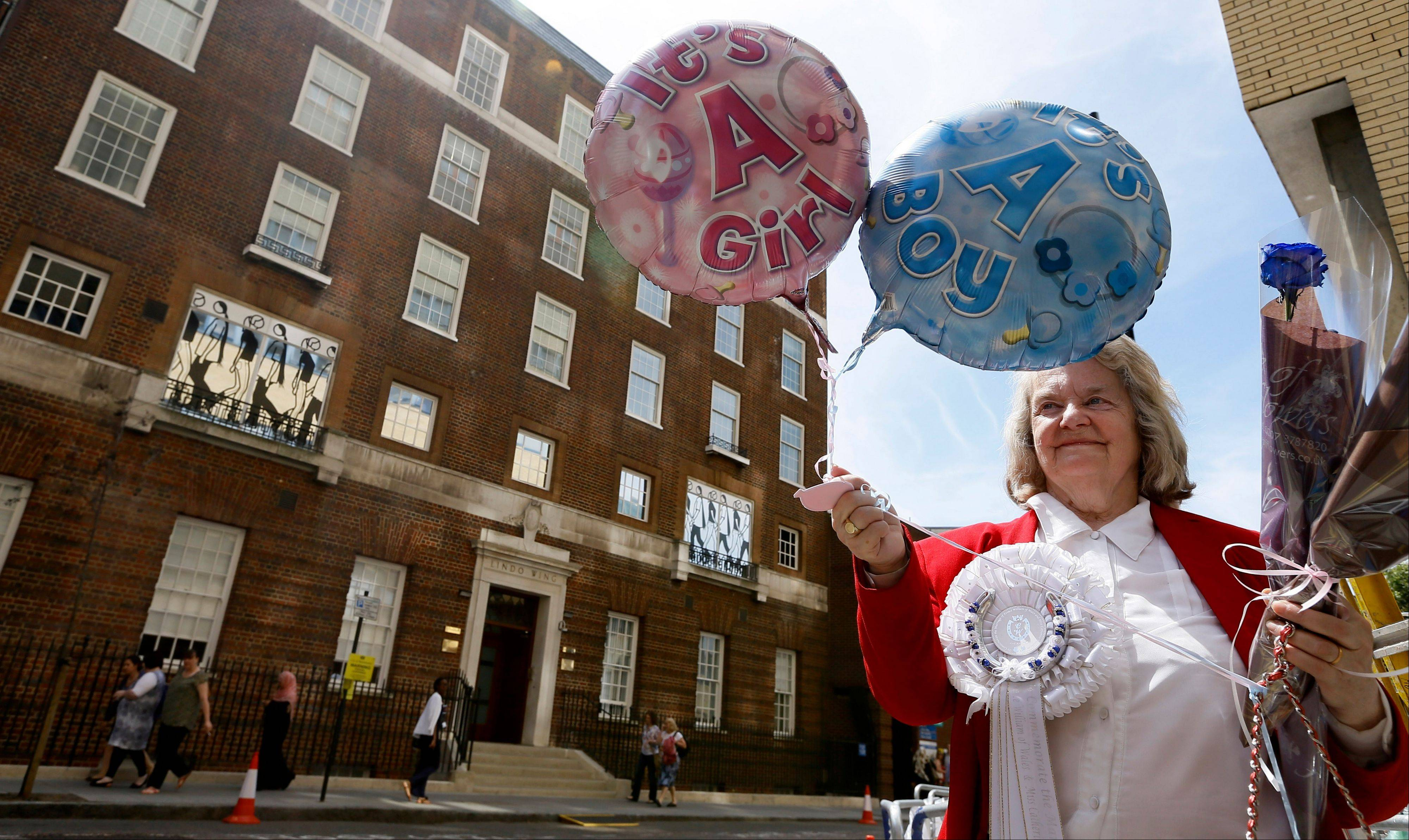 Royal supporter Margaret Tyler displays balloons for the media in front of the Lindo Wing at St Mary's Hospital in London. Britain's Kate, the Duchess of Cambridge plans to give birth to her first child who will be third-in-line to the throne at the hospital in mid-July.