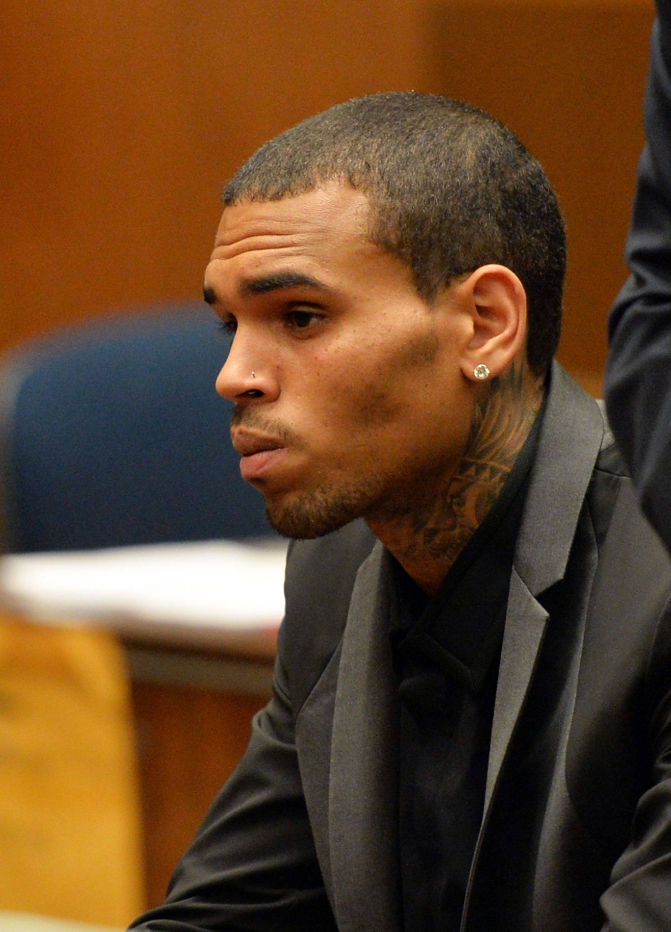 R&B singer Chris Brown appears during a court hearing at Los Angeles Superior Court Monday. A Los Angeles judge has revoked Brown's probation after reading details of an alleged hit-and-run accident and his behavior afterward, but the singer was not ordered to jail.