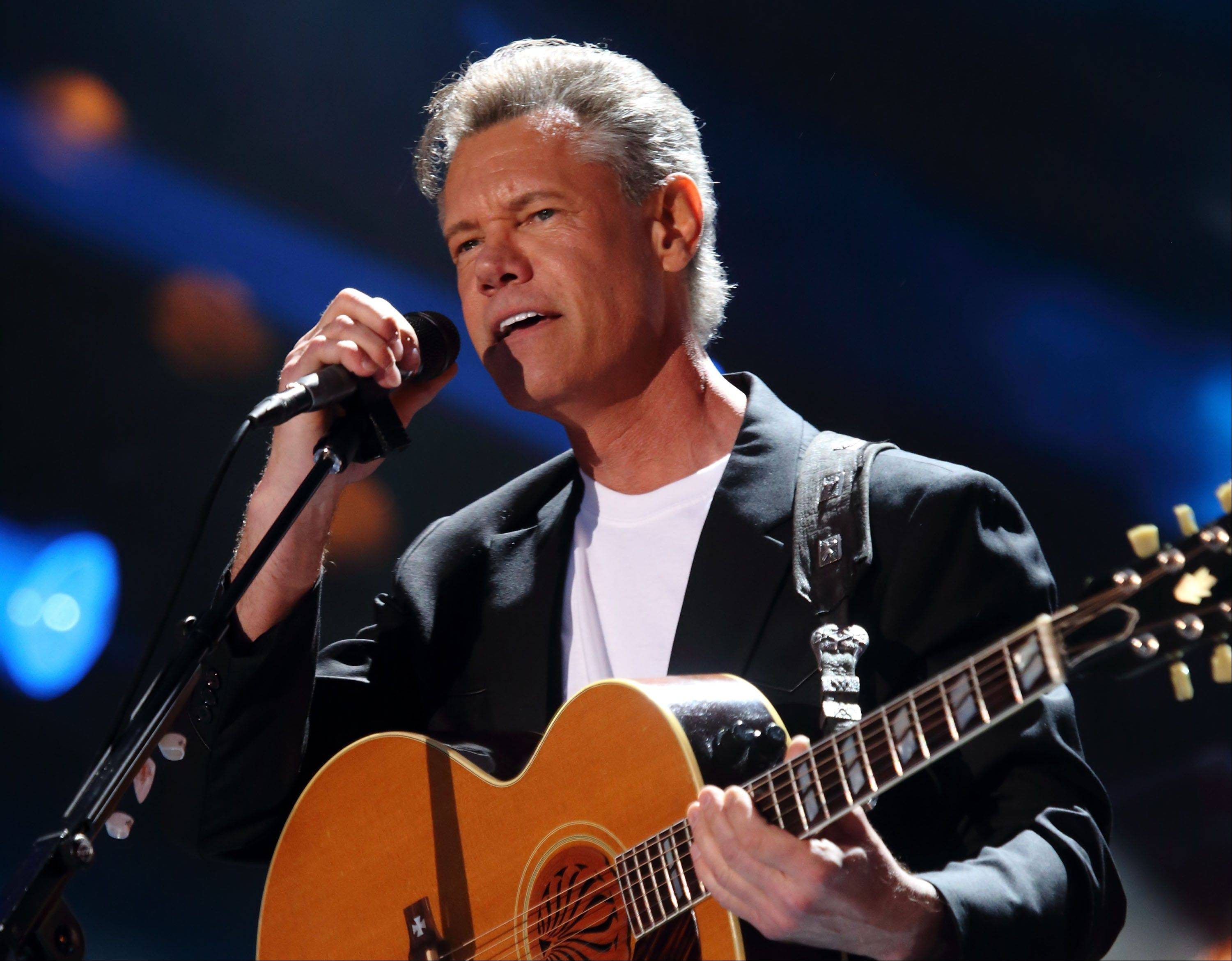 Randy Travis Travis is awake and making progress as he recovers from surgery following a stroke.