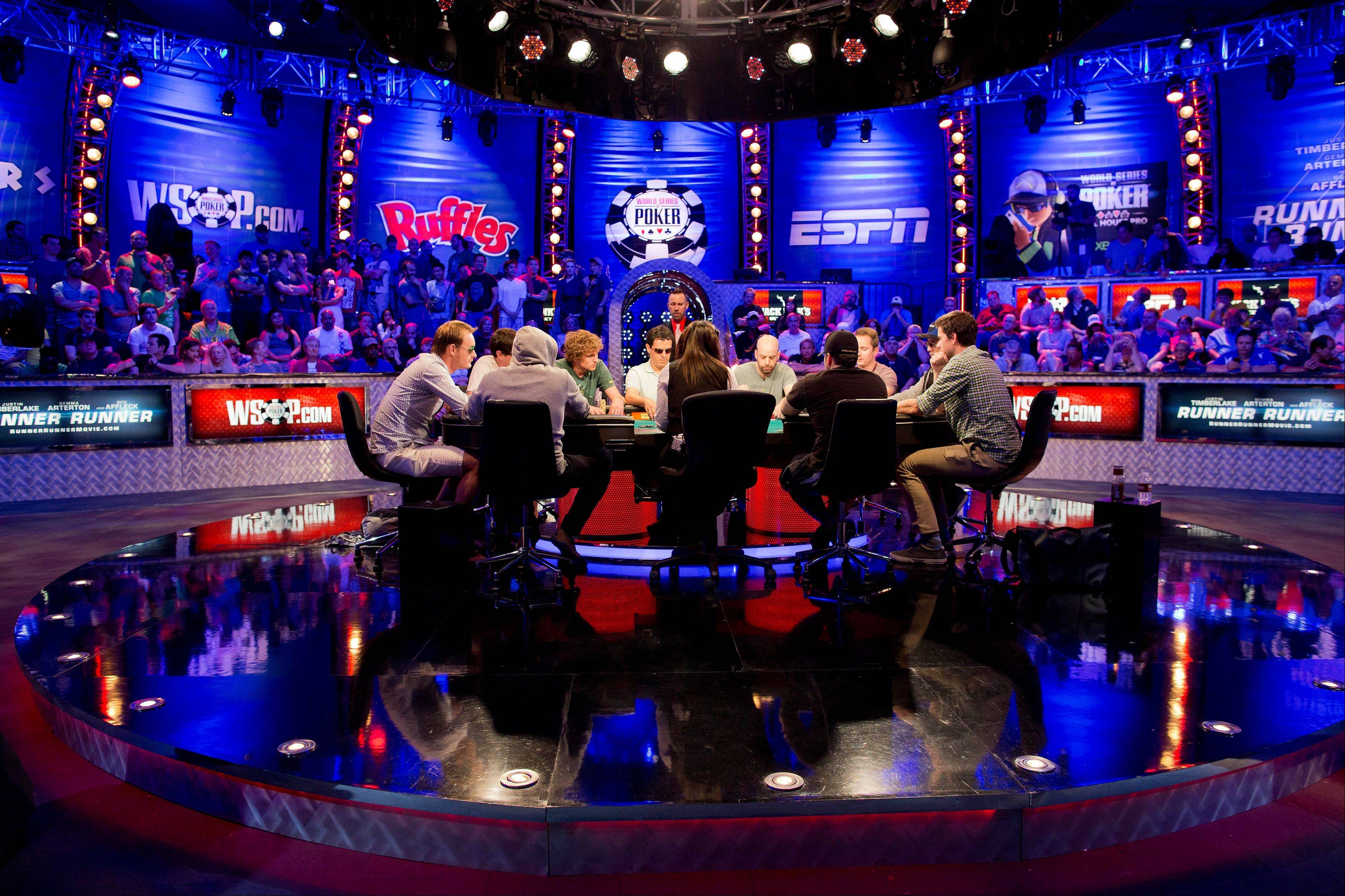 The last 10 players play a round of Texas Hold'em during the World Series of Poker Tuesday in Las Vegas. The field was whittled down to the final nine in the wee hours of Tuesday morning, with JC Tran of Sacramento, Calif., holding the chip lead.