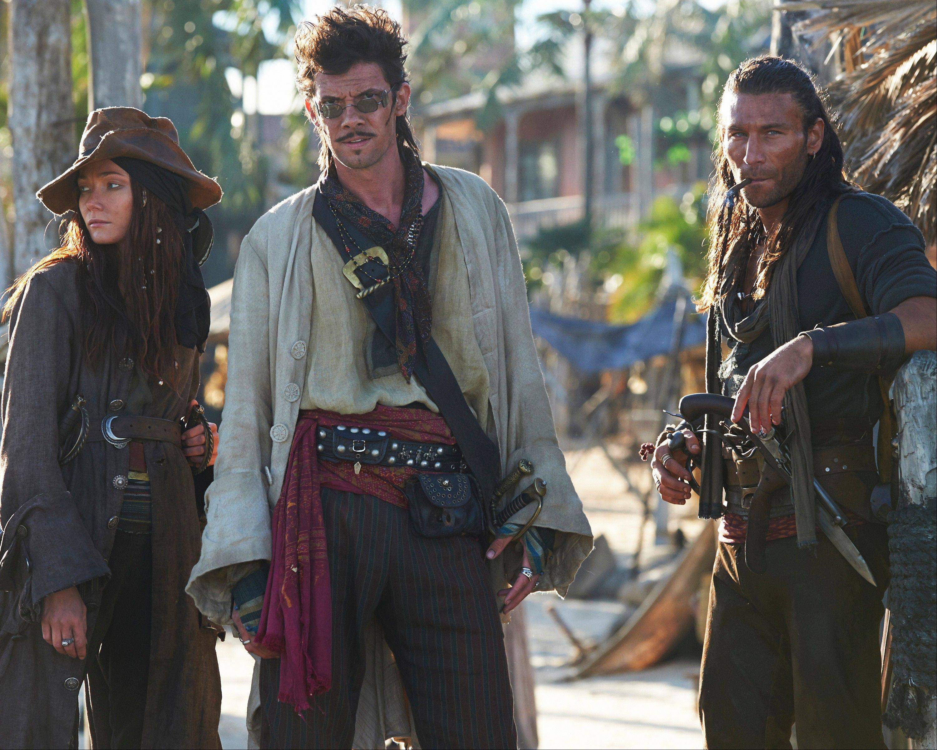 """Black Sails,"" starring Clara Paget, left, as Anne Bonny, Zach McGowan as Captain Charles Vane and Toby Schmidt as Jack Rackham, isn't scheduled to dock until next year, but Starz is screening the first episode of the mature pirate drama near the San Diego Convention Center during Comic-Con."
