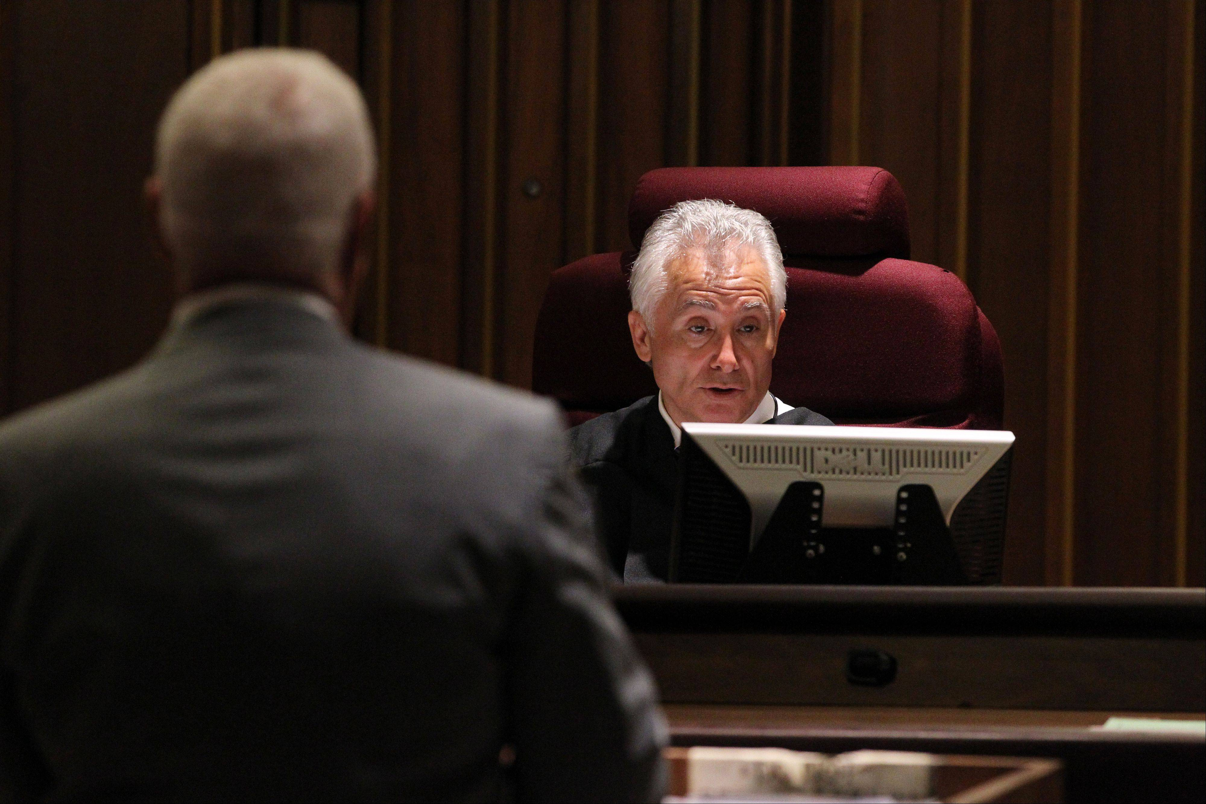 Douglas Zeit, left, attorney for Carly Rousso, stands before Lake County Judge James Booras during a hearing for his client on Tuesday. Rousso was not in court because, Zeit said, she has been admitted into an inpatient treatment center in Chicago. Her trial is to begin later this year.