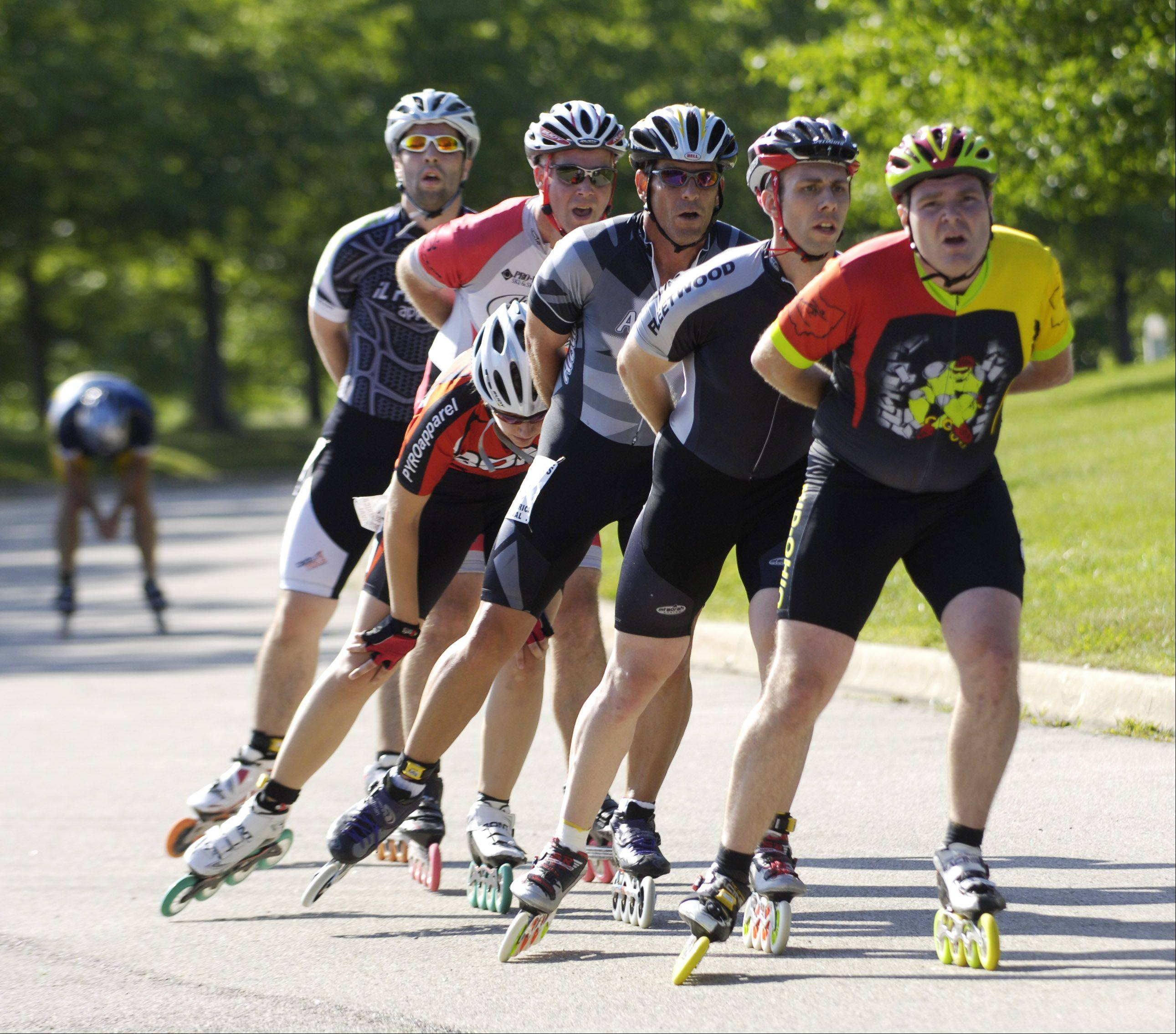 Racers in the pro inline skate tour 10k circuit race are bunched tightly as they roll downhill at the Alexian Brothers Fitness for America Sports Festival.
