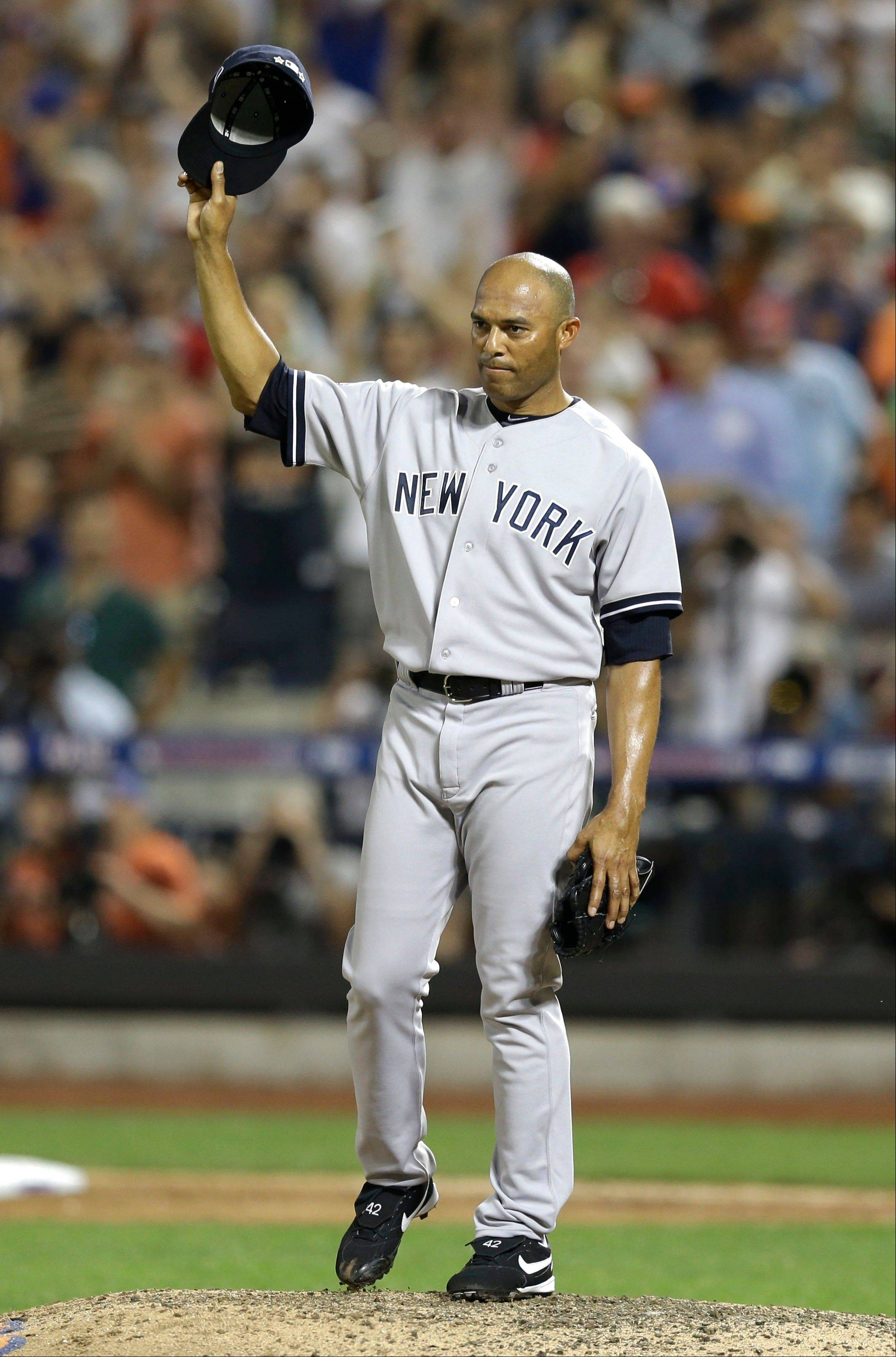 American League's Mariano Rivera of the New York Yankees acknowledges a standing ovation during the MLB All-Star baseball game Tuesday night in New York. Rivera, 43, who is retiring at the end of the season, pitched a perfect eighth inning to help the American League win 3-0.