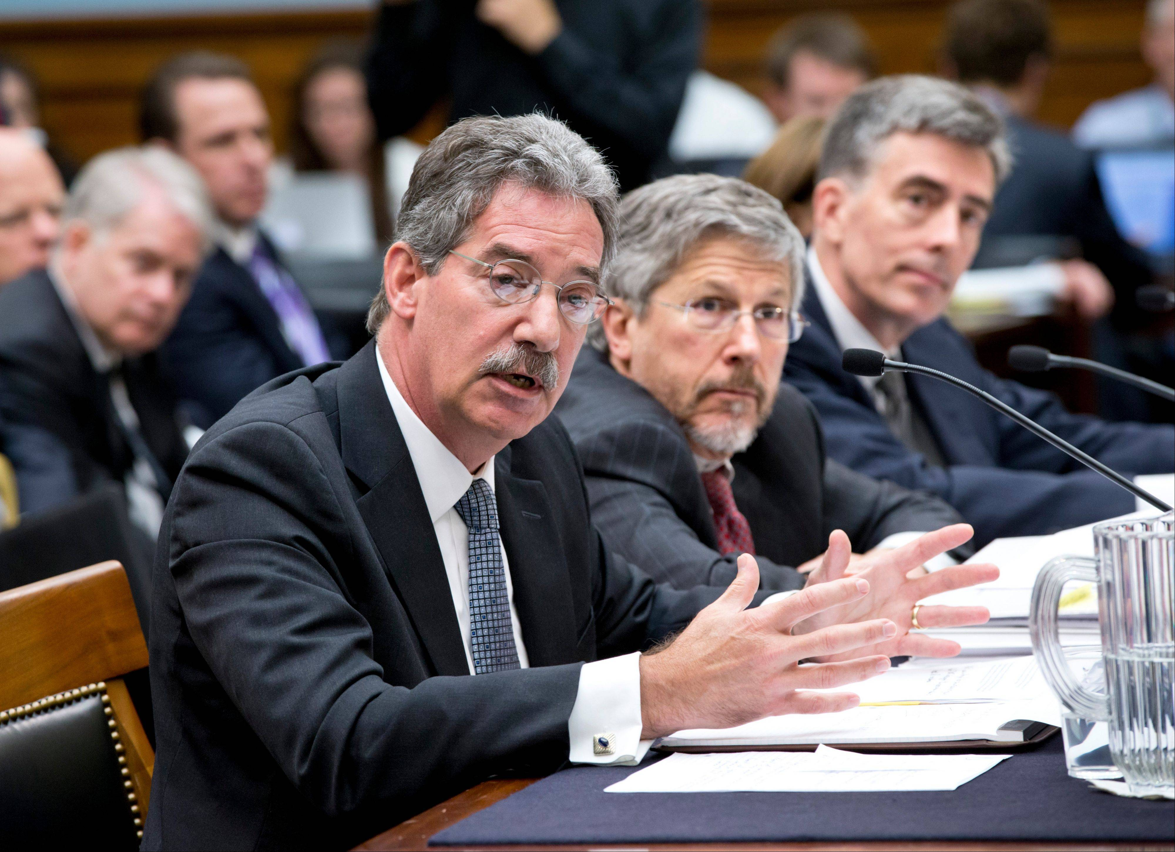 From left to right, Deputy Attorney General James Cole; Robert S. Litt, general counsel in the Office of Director of National Intelligence; and National Security Agency Deputy Director John C. Inglis testify at a House Judiciary hearing on domestic spying on Capitol Hill Wednesday.
