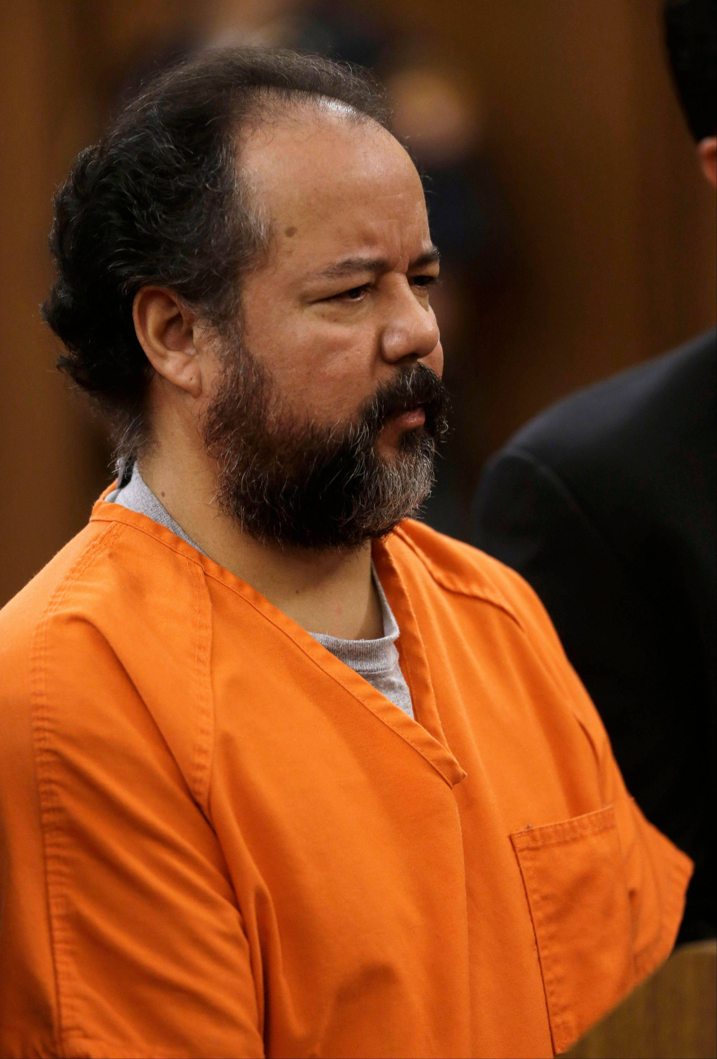 Ariel Castro stands before a judge during his arraignment on an expanded 977-count indictment Wednesday, July 17, 2013, in Cleveland. Castro is charged with kidnapping and raping three women over a decade in his Cleveland home. Castro pleaded not guilty to 512 counts of kidnapping and 446 counts of rape.
