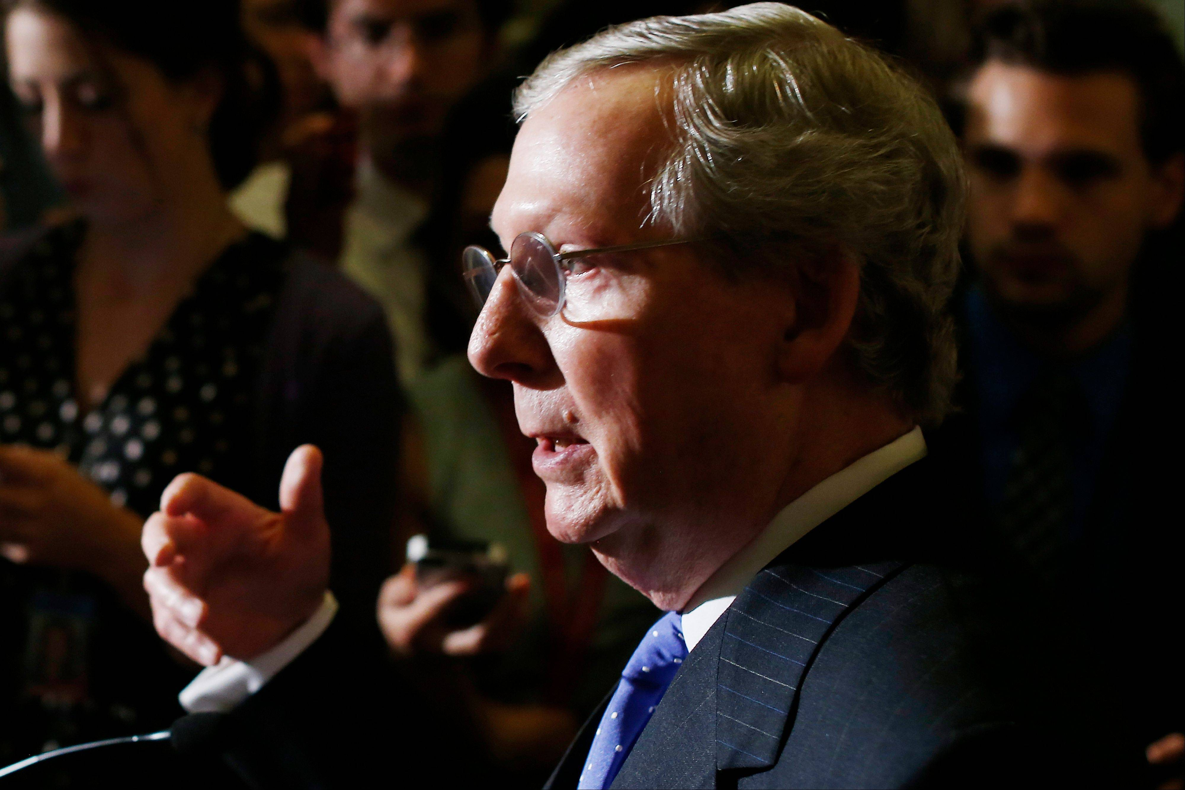 Senate Republican Leader Mitch McConnell of Kentucky speaks to reporters as lawmakers moved toward resolving their feud over filibusters of White House appointees on Capitol Hill in Washington, Tuesday, July 16, 2013.
