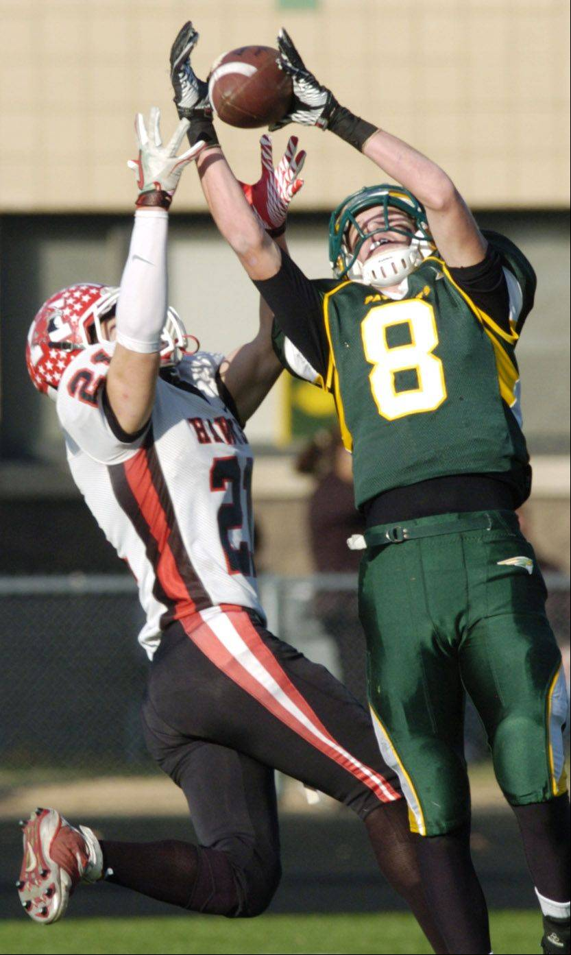 Stevenson�s Matt Morrissey, right, makes a catch in front of Maine South�s Danny Allegretti in the 2011 season. Morrissey recently committed to play football at Michigan State.