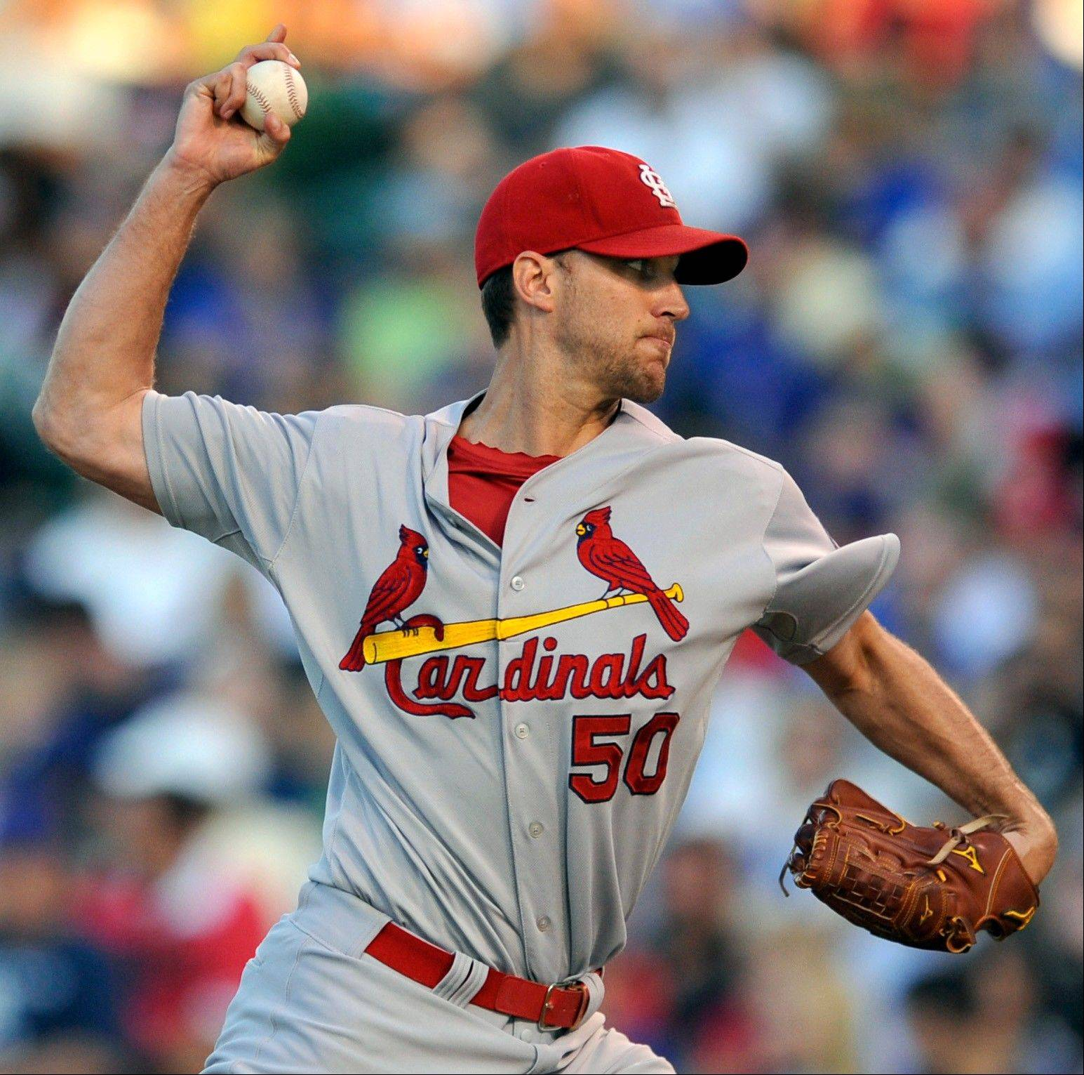 St. Louis Cardinals starter Adam Wainwright delivers a pitch during the first inning of a baseball game against the Chicago Cubs in Chicago, Sunday, July 14, 2013. (AP Photo/Paul Beaty)