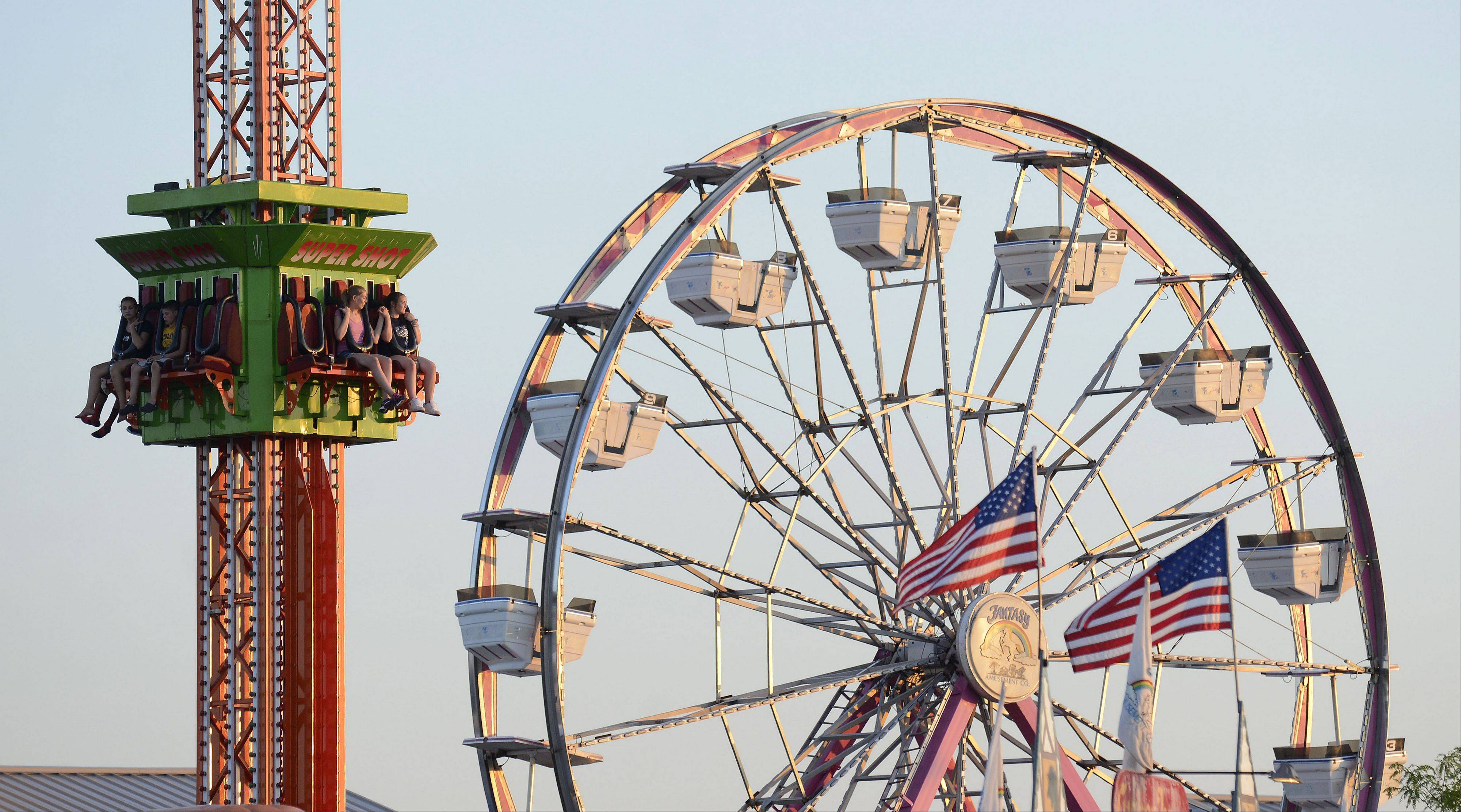 Riders on the Super Shot are raised the track at the Kane County Fair in St. Charles on Wednesday, July 17.