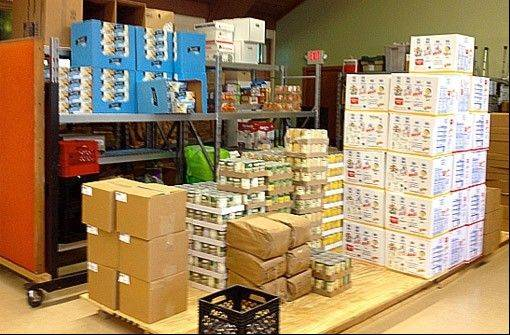 Several times a month staples are purchased at the Greater Chicago Food Depository and stored in the church's Fellowship Hall.
