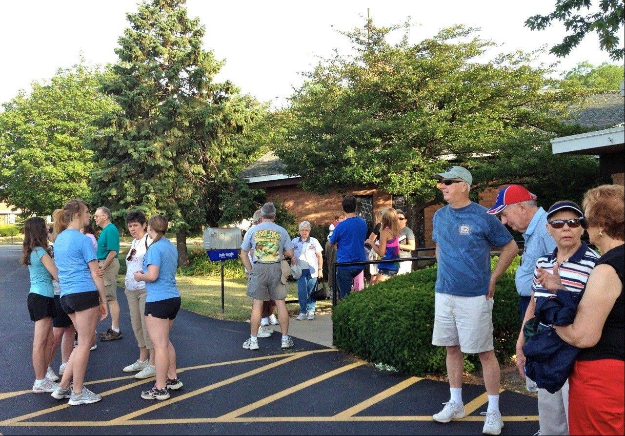 Friends and members of the Lutheran Church of the Cross gather in the church parking lot before heading to Soldier Field for the annual Greater Chicago Food Depository Hunger Walk. This year, 56 enthusiastic supporters walked the walk.