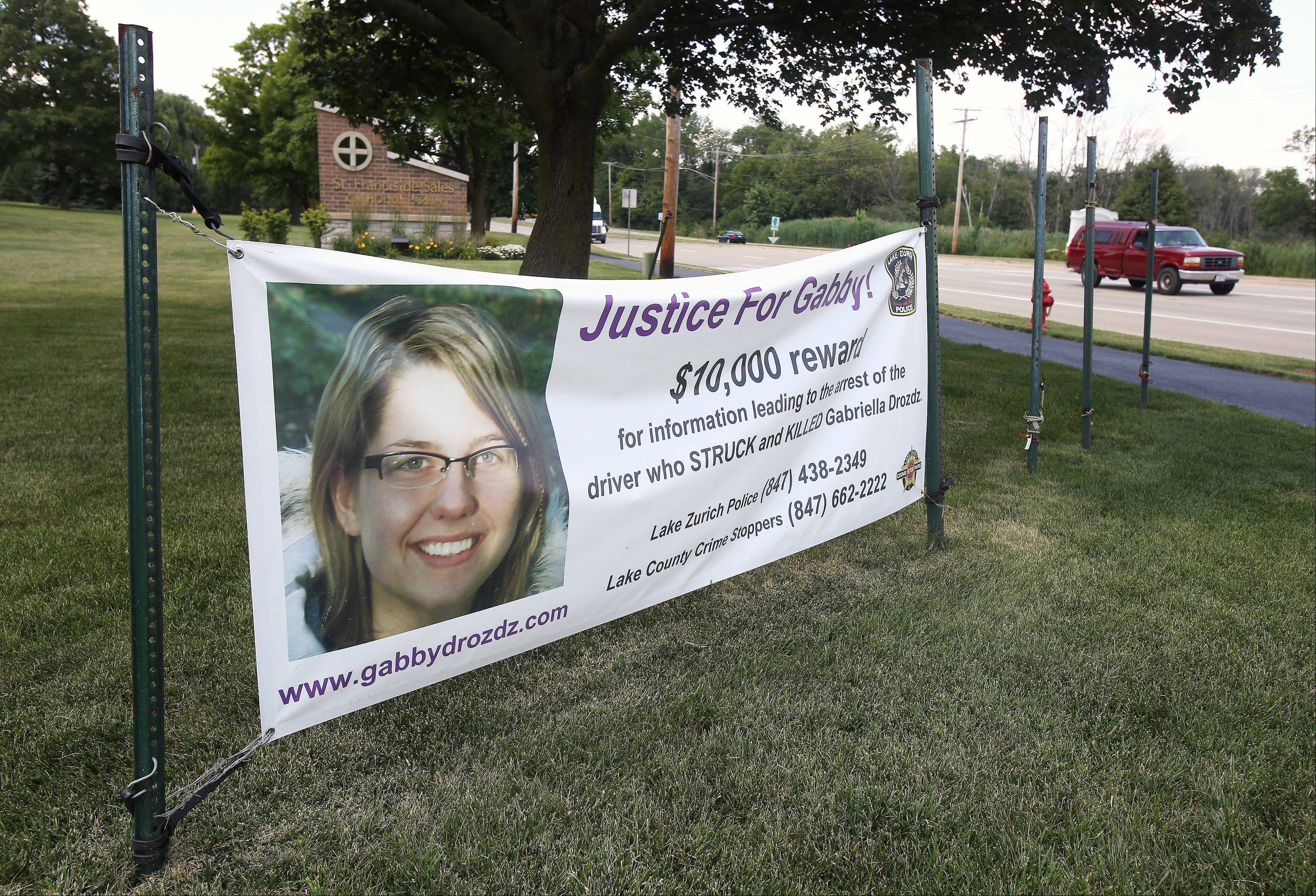 A banner seeking information about the hit-and-run crash that killed Gabriella Drozdz can be seen at Route 22 and Buesching Road in Lake Zurich. The crash occurred July 22, 2011, as Drozdz walked along Church Street to Alpine Fest at Lion Fred Blau Park.