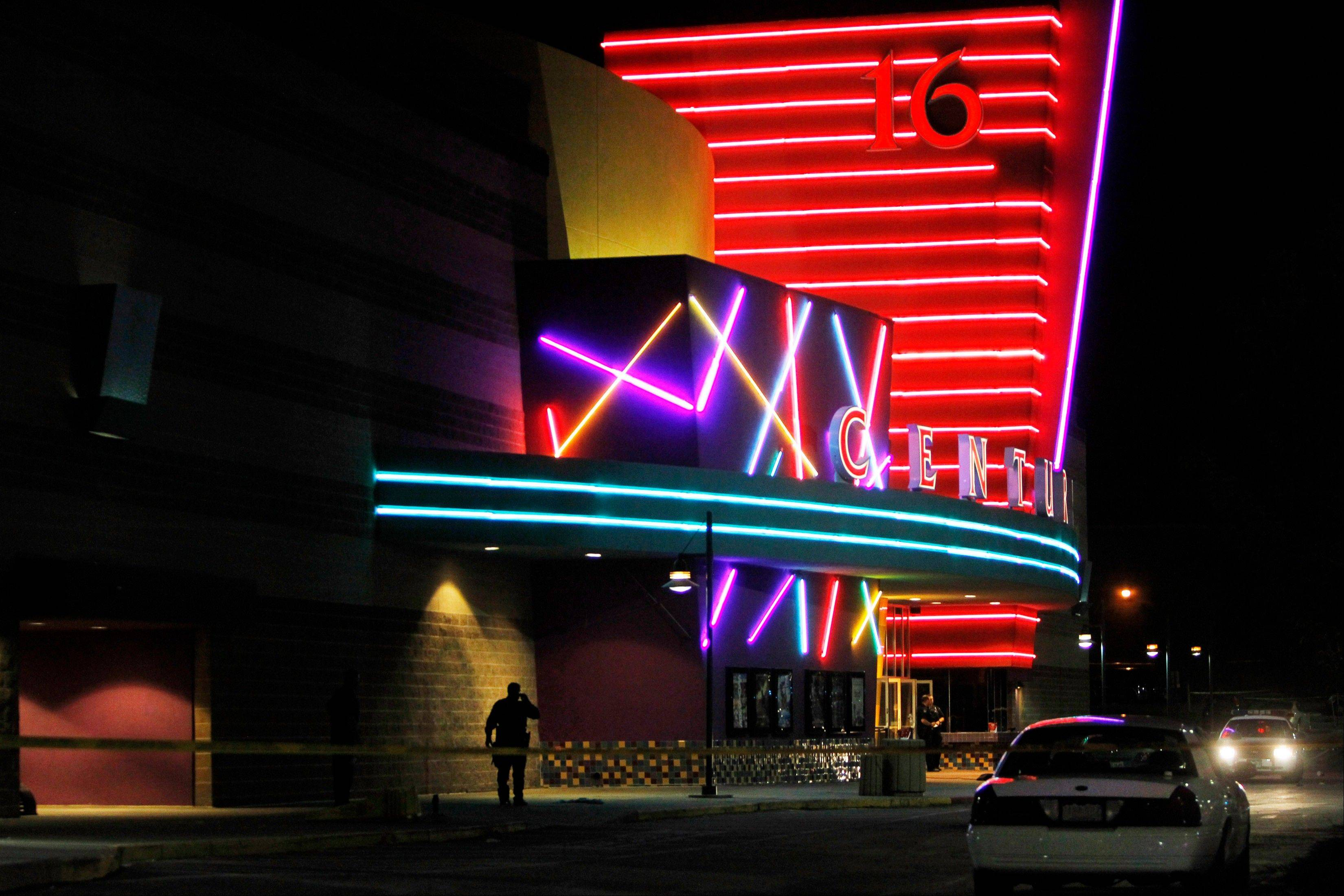 This July 20, 2012 file photo shows police outside of the Century 16 movie theater where suspect James Holmes killed 12 people and wounded 70 during the screening of a Batman movie. Eight months later, Colorado became the only state outside the Democratic Party's coastal bases to pass sweeping gun control laws.