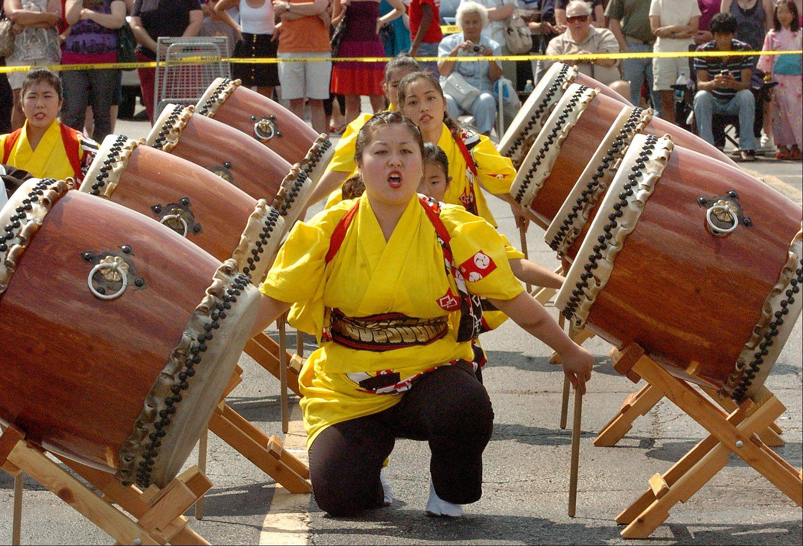 Kiyomi Negi of the Tsukasa Taiko Japanese Drummers performs at the Mitsuwa Marketplace summer festival in Arlington Heights.