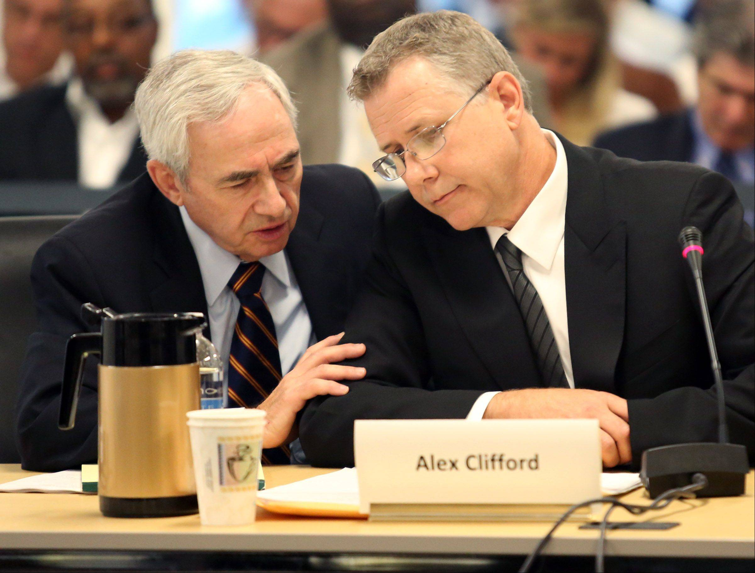 Former Metra CEO Alex Clifford speaks Wednesday to his attorney Michael Shakman before answering a question during the RTA board.
