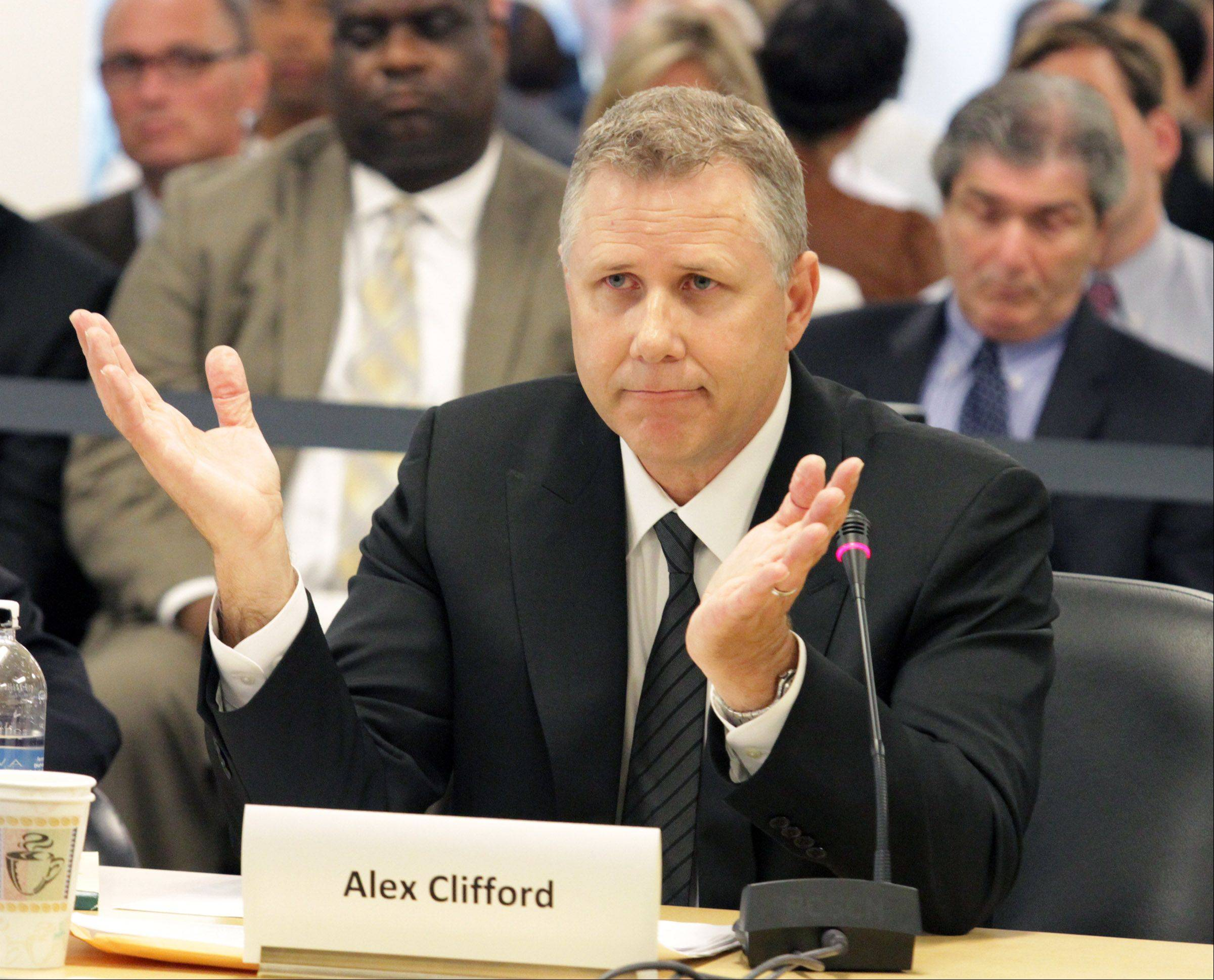 Former Metra CEO Alex Clifford speaks Wednesday to the RTA board about allegations of political patronage that led to his departure from Metra.