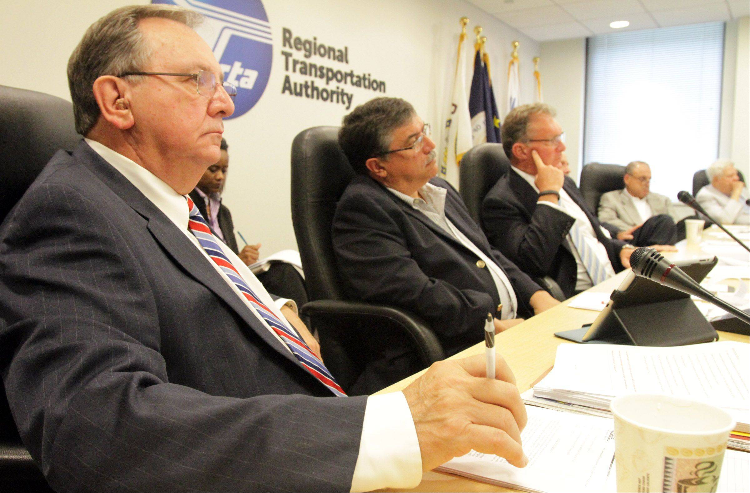 RTA board members, including Patrick Durante, from left, Phil Fuentes, and Chairman John Gates, listen to Former Metra CEO Alex Clifford speak on Wednesday.