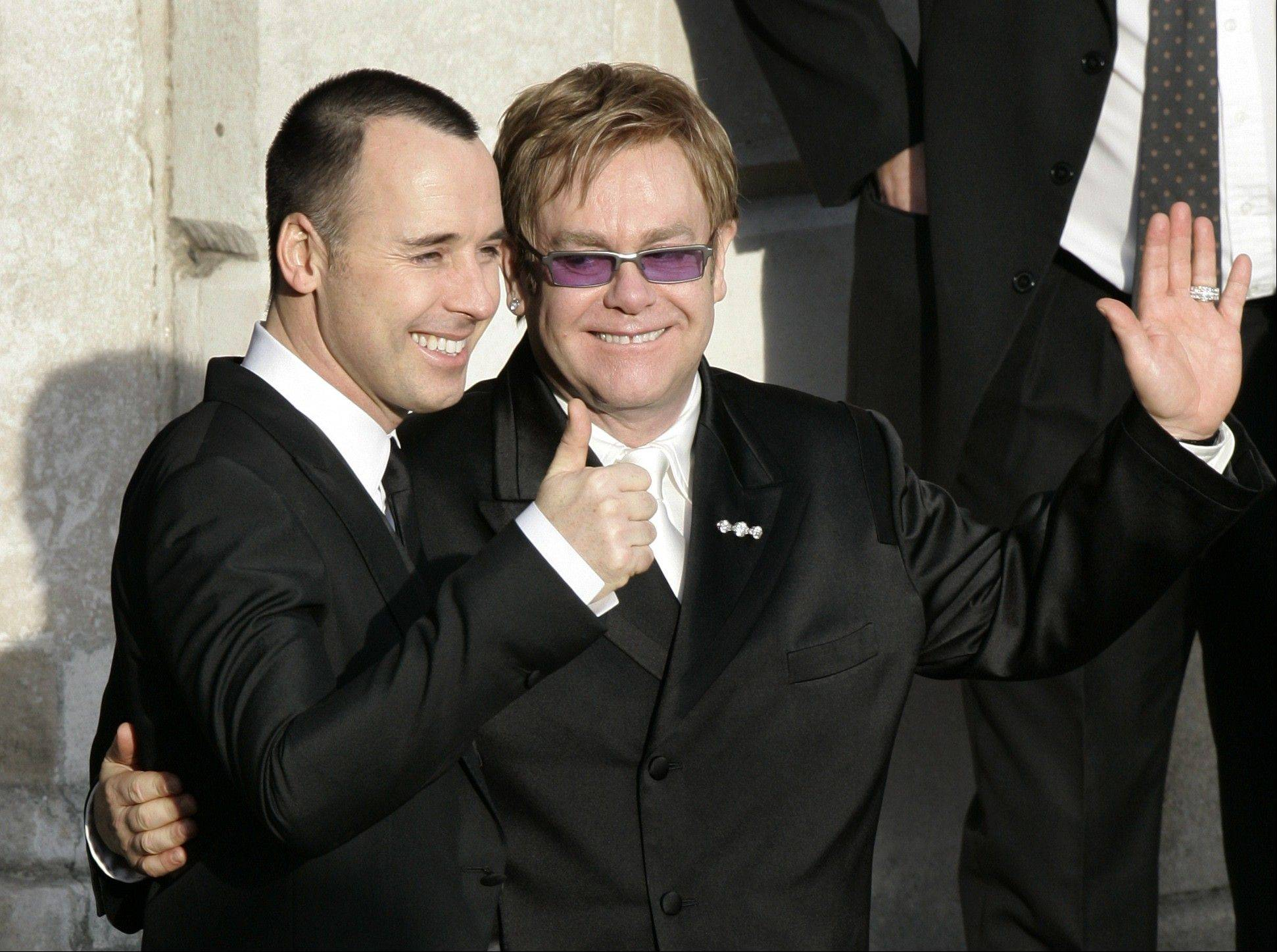 Pop star Elton John, right, and his longtime partner David Furnish were the most prominent of hundreds of same-sex couples planning to form civil partnerships in England and Wales on Wednesday, the first day that such ceremonies become possible.