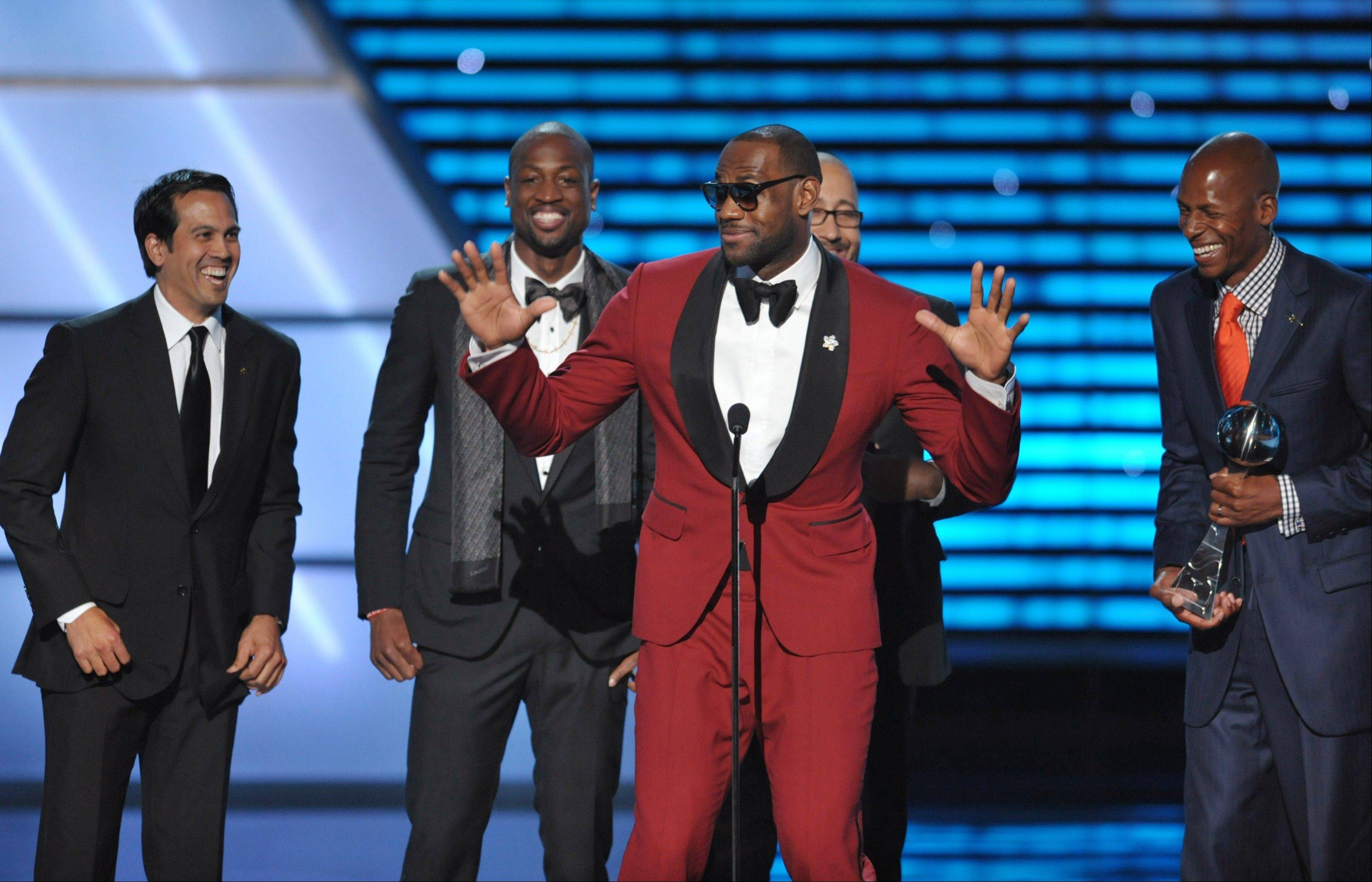 From left, Miami Heat coach Erik Spoelstra and players Dwyane Wade, LeBron James and Ray Allen accept the award for best game at the ESPY Awards Wednesday night at the Nokia Theater in Los Angeles.