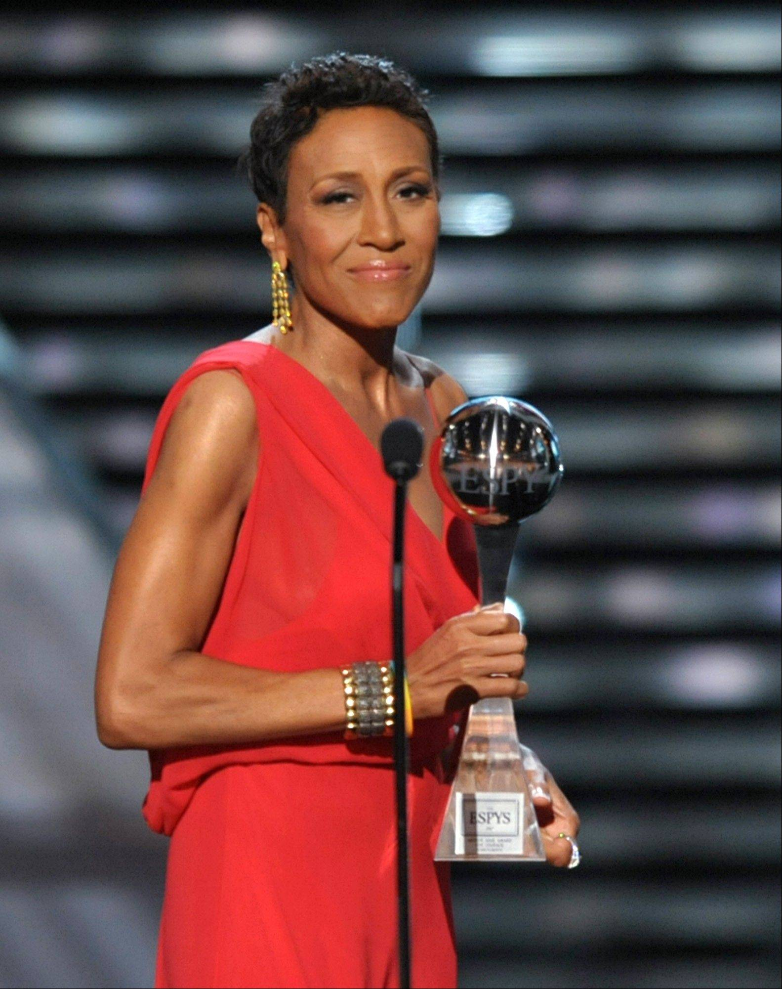 Television host Robin Roberts accepts the Arthur Ashe courage award at the ESPY Awards Wednesday night at the Nokia Theater in Los Angeles.