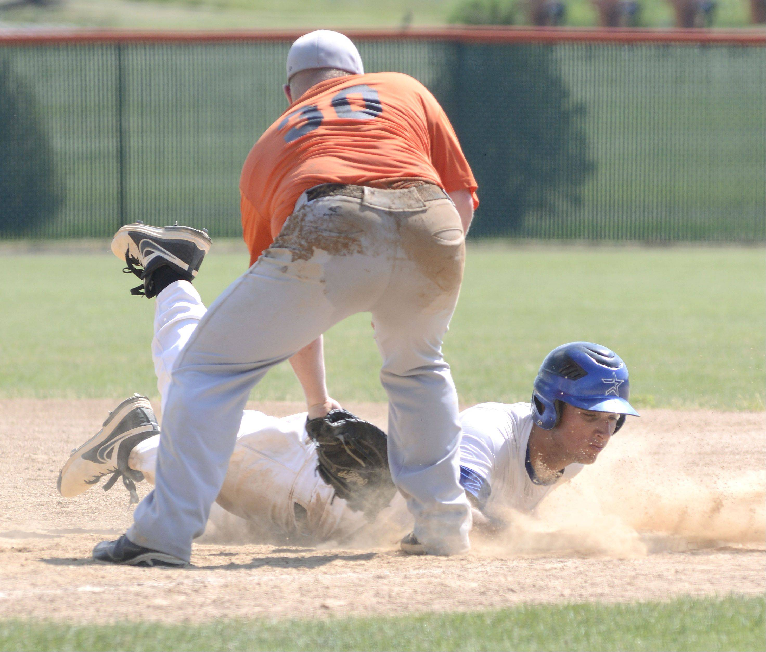 St. Charles North's Joe Kuczek is tagged by St. Charles East's Ben Smith on first base in the fourth inning of the St. Charles East summer tournament semifinals on Wednesday, July 17.